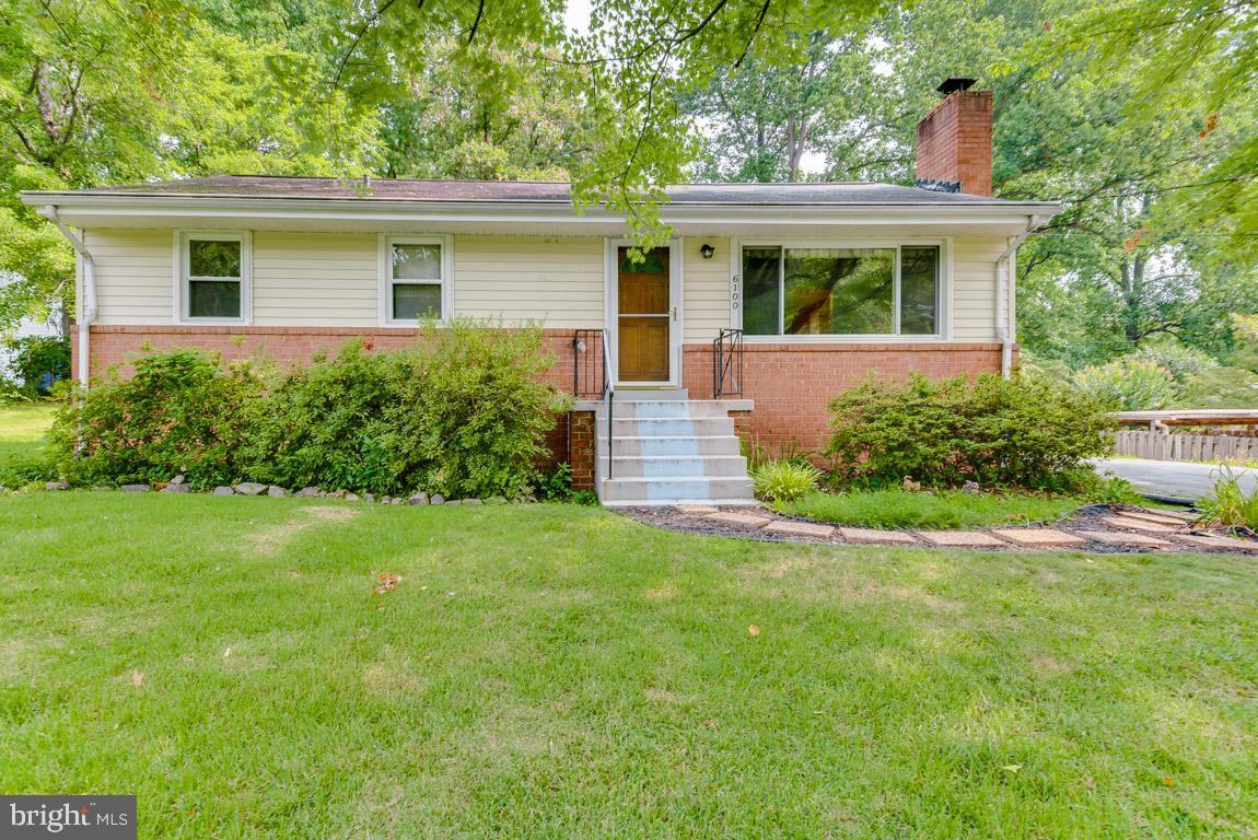 LOVELY RAMBLER ON A HALF ACRE PARK LIKE SETTING IN SOUGHT AFTER WEST LAUREL ACRES.