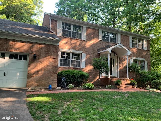 Custom built and very well maintained all brick colonial home with pool on a 4.44 acre private woode