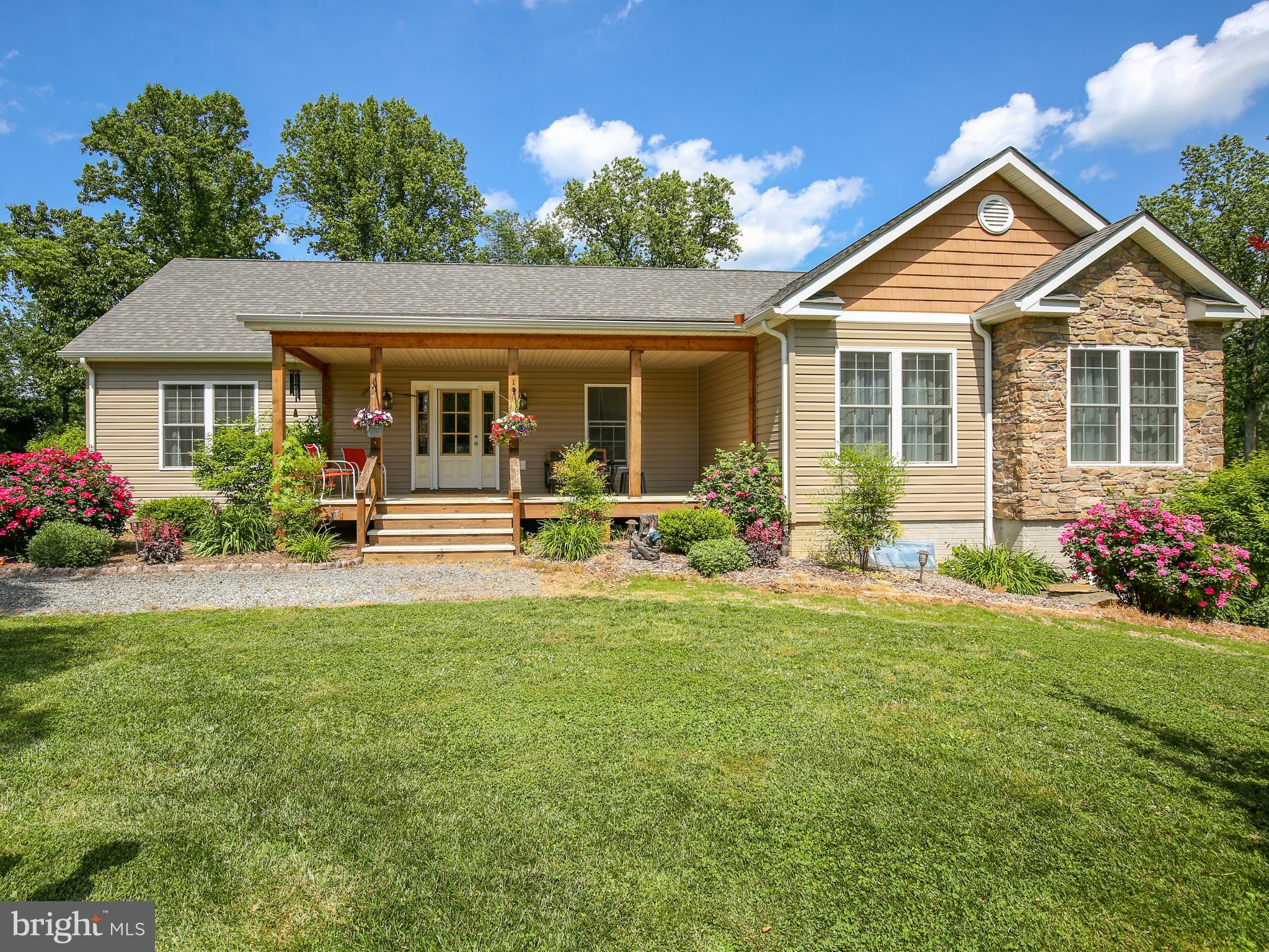Beautiful, well-maintained, main level living ranch style home on 2 park-like landscaped acres.  Hom