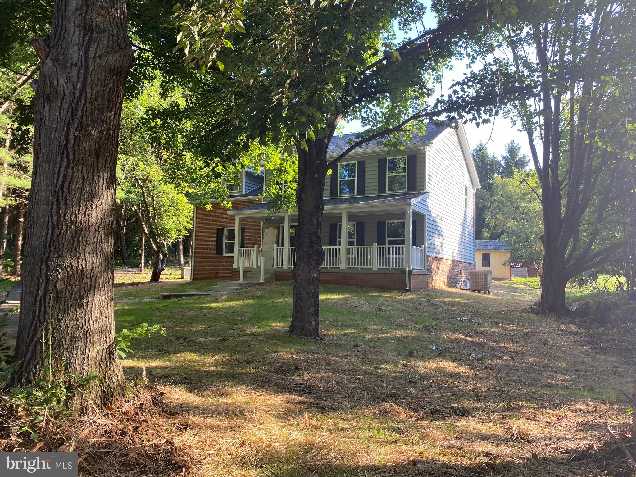 Privacy and seclusion abound in this completely remodeled and updated 4 BR, 2.5 Bath home situated o