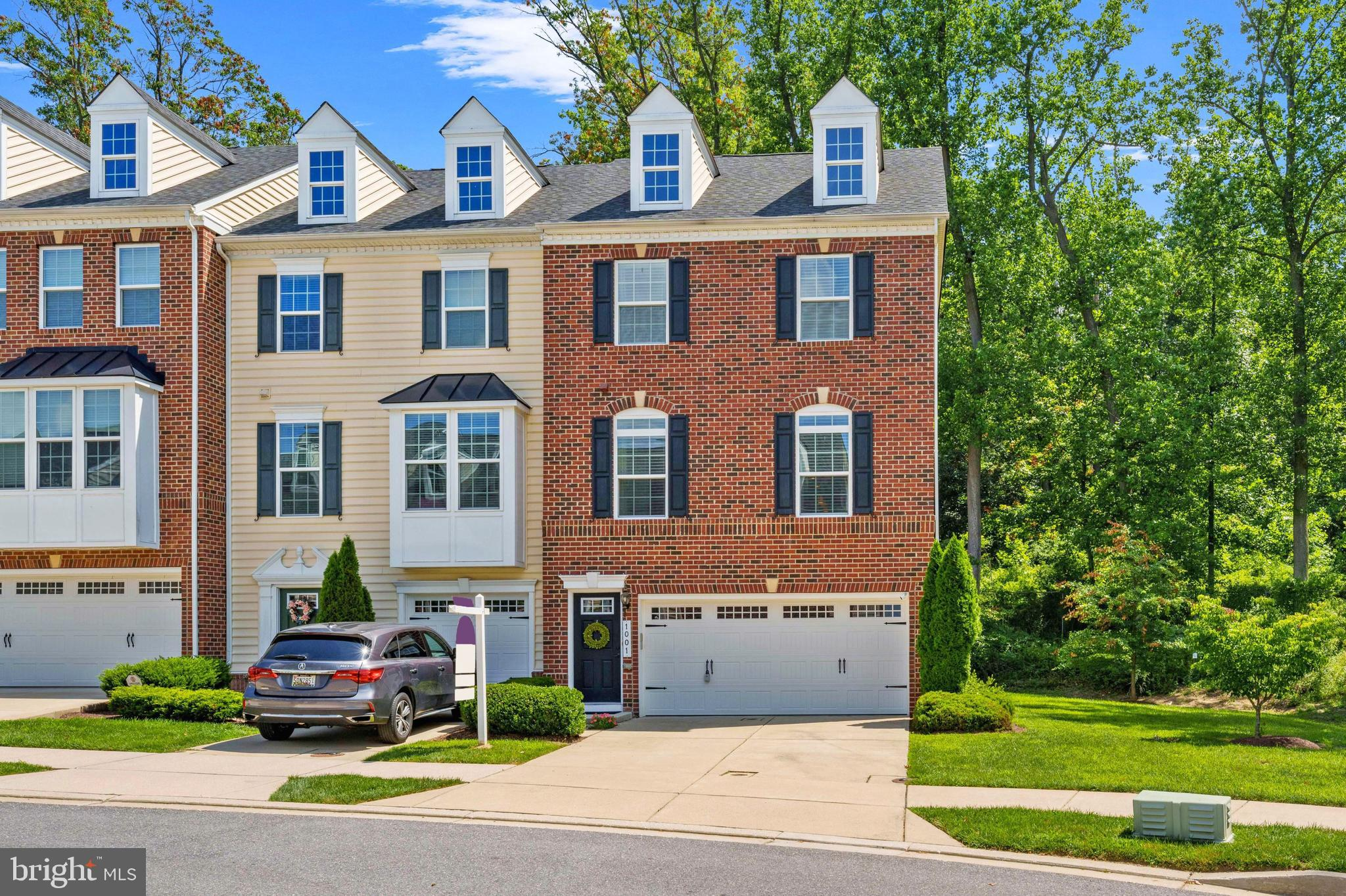 Book your appointment today to tour this beautiful oversized, light-filled end unit townhome in the community of Raincliffe. Enjoy the convenience of the attached 2-Car garage and 2-Car parking pad, perfect for guests. Built in 2014, this pristine home boasts a spacious open concept main level complete with hardwood flooring throughout the Dining Room, Living Room, and gourmet Kitchen featuring granite countertops, stainless steel appliances, and an island. Access the balcony through the Dining Room, overlooking the lush woods behind your home. The lower level contains a spacious carpeted Recreation Room with walkout access to the rear yard and a Full Bath. The rear covered porch is ideal for creating your own oasis, be it a plush sitting area or a place to play on rainy days. Your home is completed with 3 well-appointed bedrooms located on the upper level. The Primary Bedroom is regal and refined, bask in the tray ceiling, recessed lighting, walk-in closet, and spa-like Ensuite.  No need to struggle with laundry any longer, Laundry Room is located on the upper levels alongside the bedroom. Book your appointment today to secure your chance to tour this lovely home.