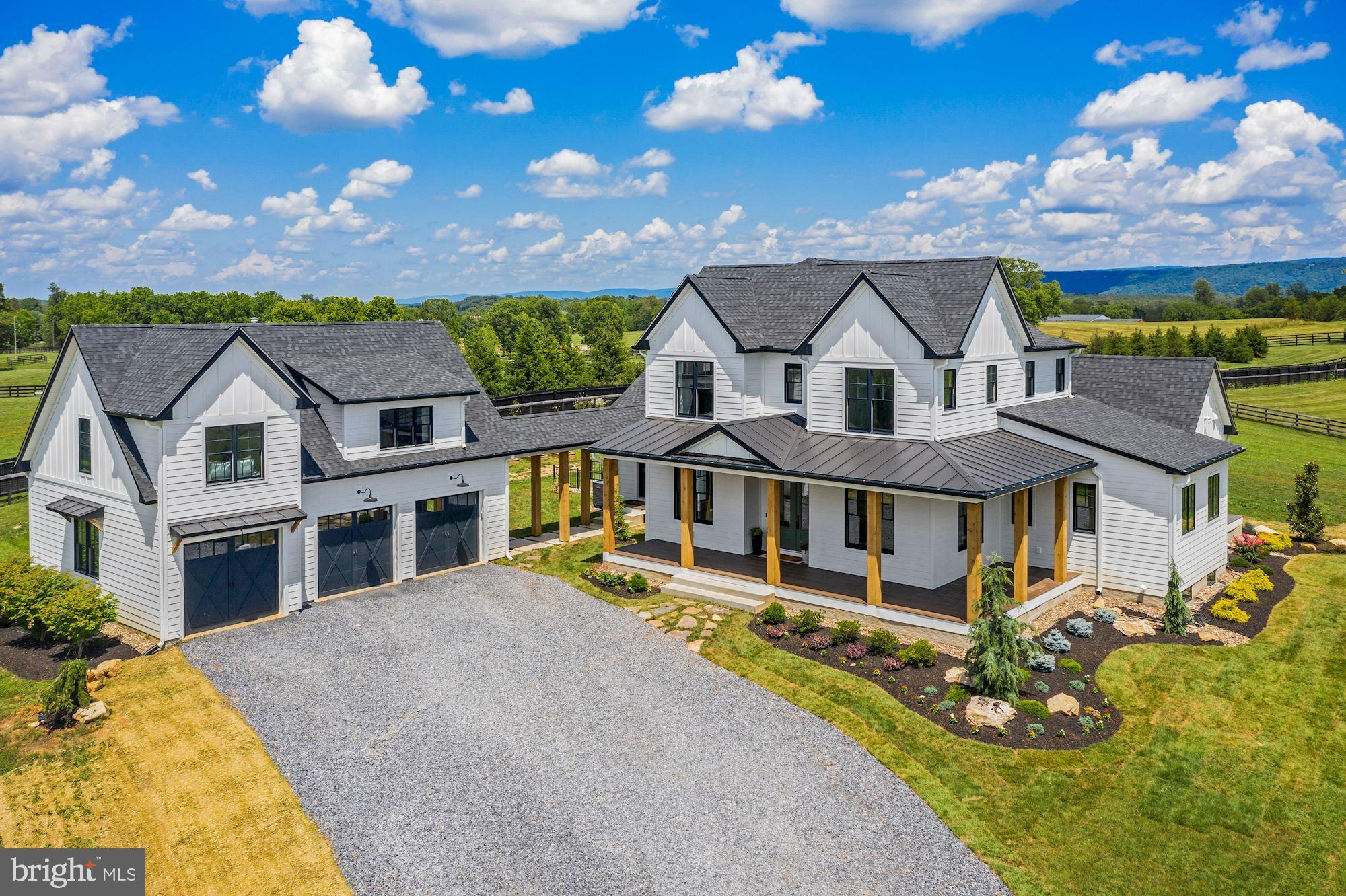 Built in 2019, this luxurious modern farmhouse situated on 10+ peaceful acres offers 6,110+/- square