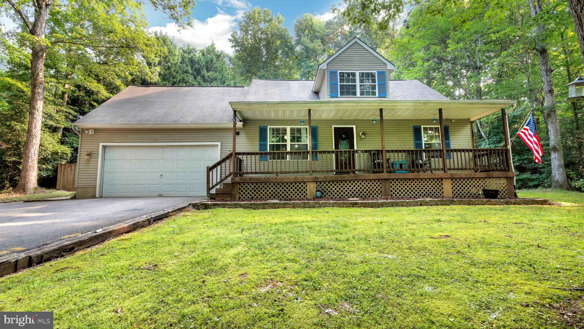 Don't miss your chance to own this adorable cape cod with a 2 car garage! This well maintained home