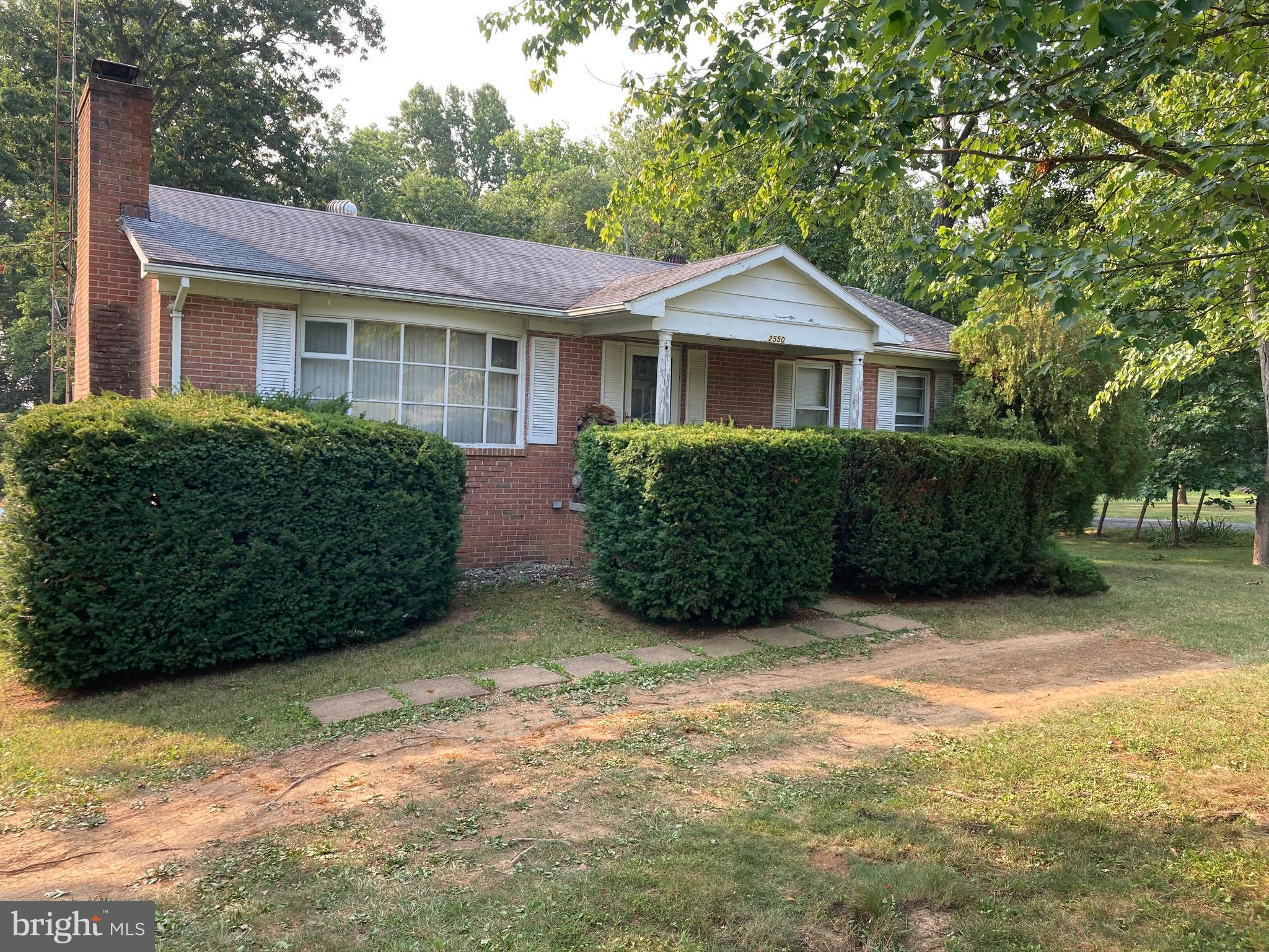 Unrestricted on just over a acre ,NO HOA .Brick rancher built in 1987.All the trees and  with views