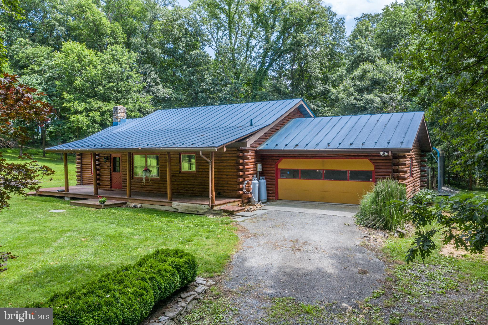 Amazing cedar log cabin with gorgeous front porch, nestled on 5 fully fenced acres.  Ultimate privac