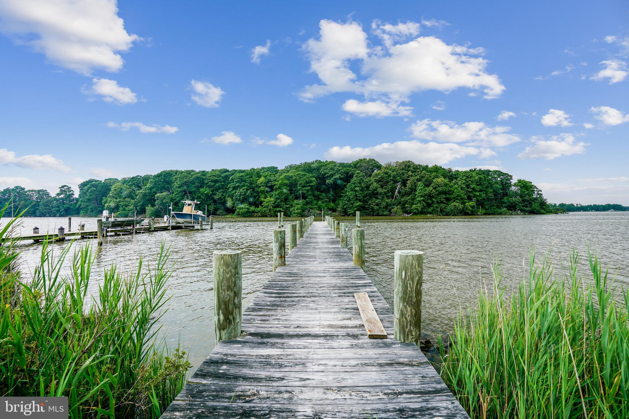 Still time to enjoy the summer fun in this amazing waterfront custom home.   Flat lot on Cox Creek w