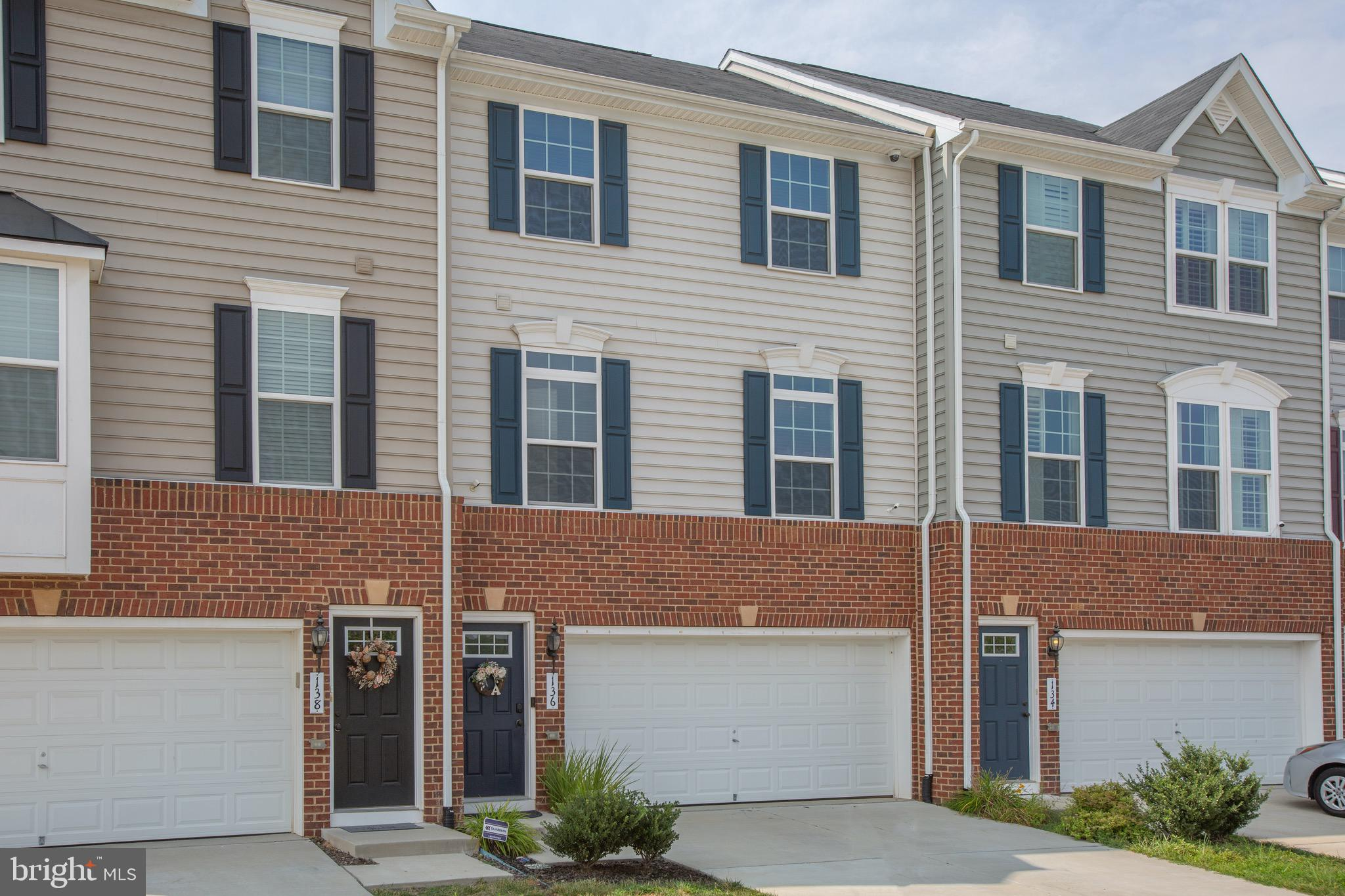 Welcome Home to this Gorgeous 3 Bedroom 3.5 Bath Townhome. You will Love the Main Level with a Large