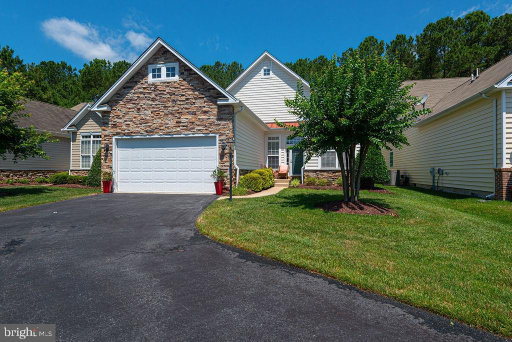 Extraordinary gem of a home in the Premier Plus 55 Community of the Parke of Ocean Pines. This two level 4 bedroom,3 bath home features a Gorgeous Great Room, Formal Dining Room, Gourmet Kitchen Breakfast Room, Sunroom, First level owner suite plus oversized 2  car garage home and is available for immediate enjoyment. Home showcases natural light throughout with cathedral ceilings and 2 skylights in great room, kitchen and breakfast room! Exceptional features to the home include, hardwood floors, crown molding, a gourmet kitchen with granite counter tops, upgraded cabinetry with pull outs, large walk in pantry, extended breakfast bar and breakfast room. Enjoy entertaining family and friends in great room off kitchen with see thru marble mantled Fireplace or in oversized Sunroom with planation shutters and/or on the extensive brick private outdoor patio.  Relax in the secluded Primary Suite featuring tray ceiling; designer ceiling fan and custom window treatments. Master bath includes 5 foot jetted soaking tub, seated tiled shower and double vanities. Split floor plan with 2 large bedrooms on first level and beautiful loft with full bedroom and bath on second floor will give privacy to your guests and family. Separate, laundry room with cabinetry and front load Washer and Dryer! Home is complete with an lawn irrigation system an extra-long driveway for family and guest parking. Purchase now and Enjoy the Parke and Ocean Pines with all its amenities! Dining Room Furniture is negotiable and home is MOVE IN READY. So why wait to enjoy the beach lifestyle now is the time to buy. Call for your private showing today.