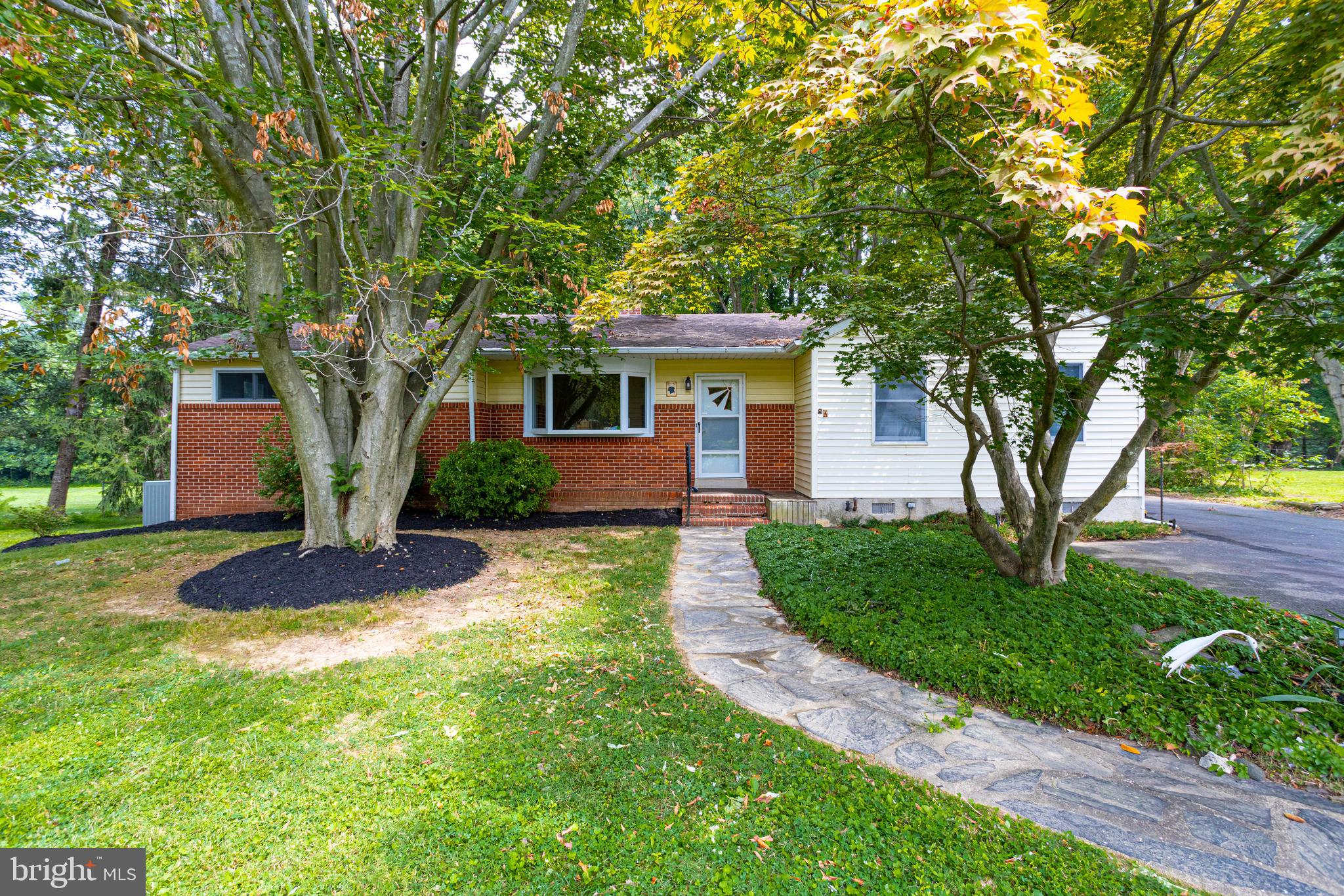 Beautiful and spacious partial brick front rancher on sprawling .40 acre lot in Bagley's Venture! En