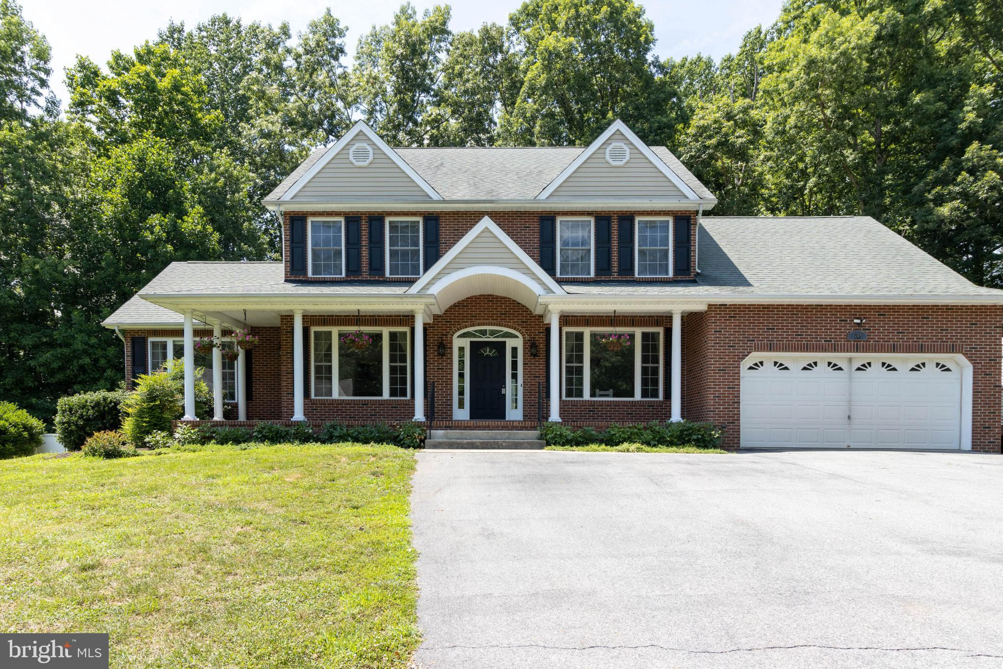 THIS IS THE ONE! IMMACULATELY MAINTAINED GORGEOUS COLONIAL ON QUIET LOT IN THE HEART OF HUNTINGTOWN.