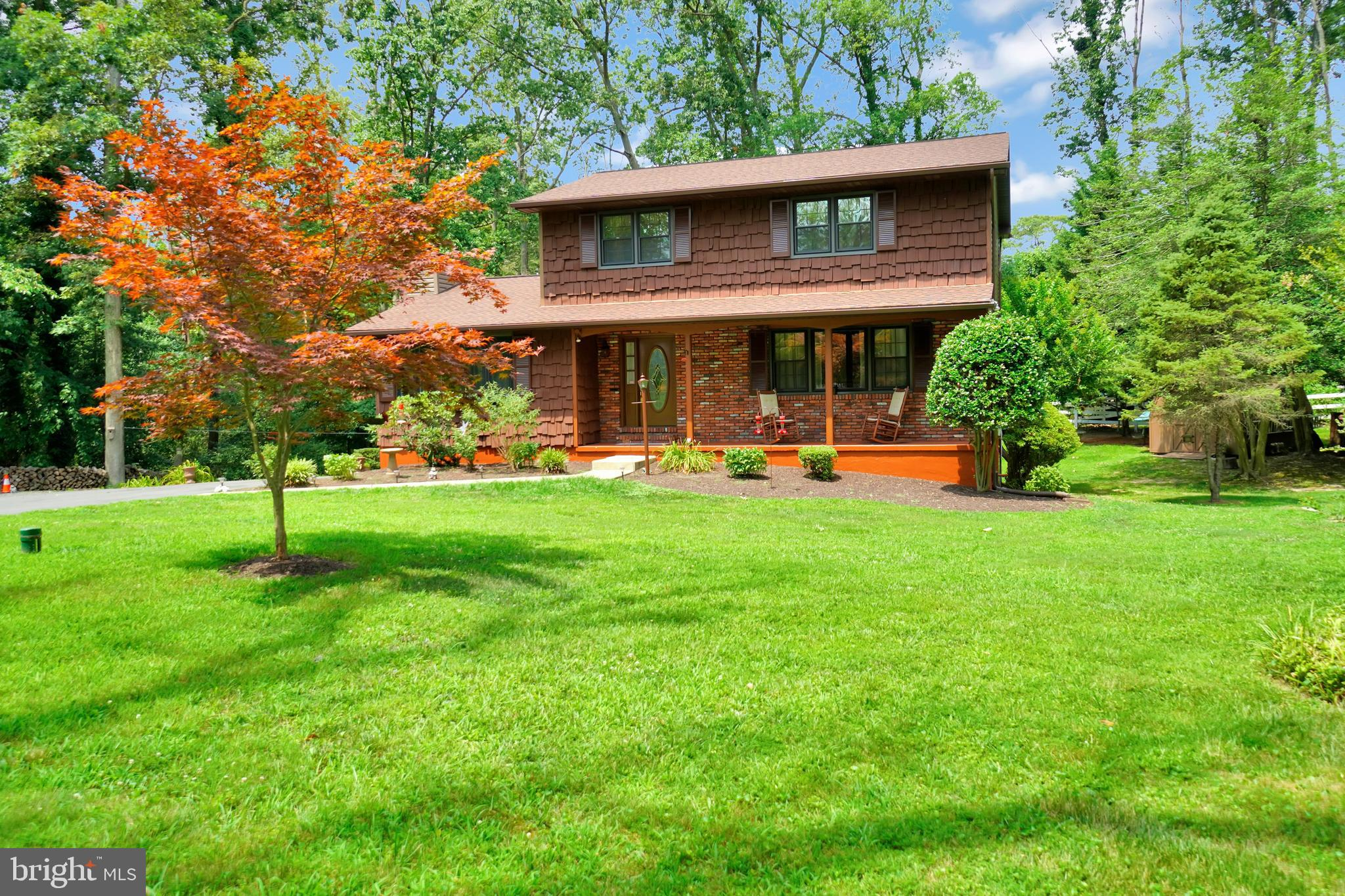 This 5 Bedroom, 3 Full Bath, and 1 Half Bath Colonial is located on over a half of an acre wooded lo