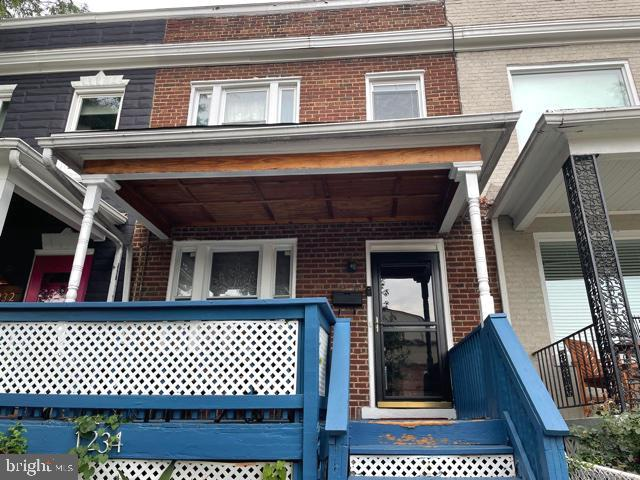 Brick Interior Row 3 Level House located in Trinidad Community.  Lovely row house is ready to take i