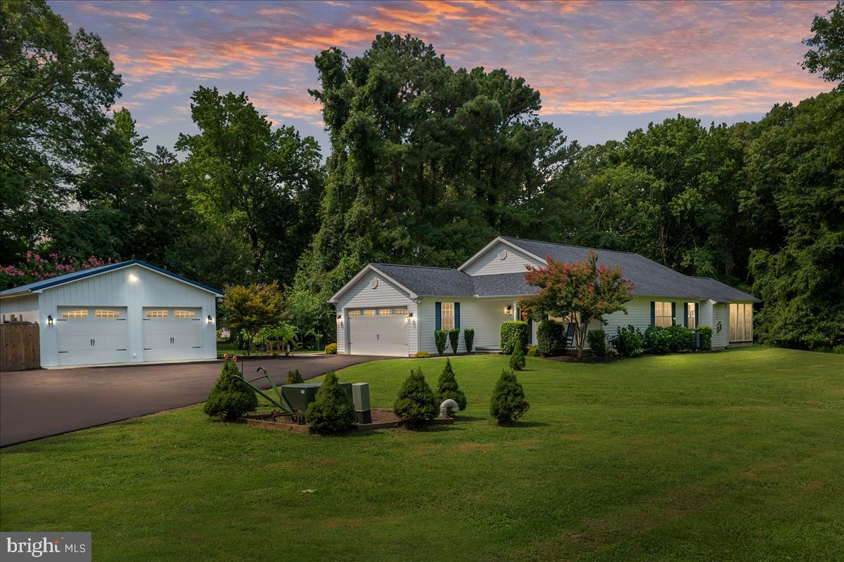 Nestled on a 1.2acre homesite backing to woods, this Custom built Home isn't just your Average Ranch