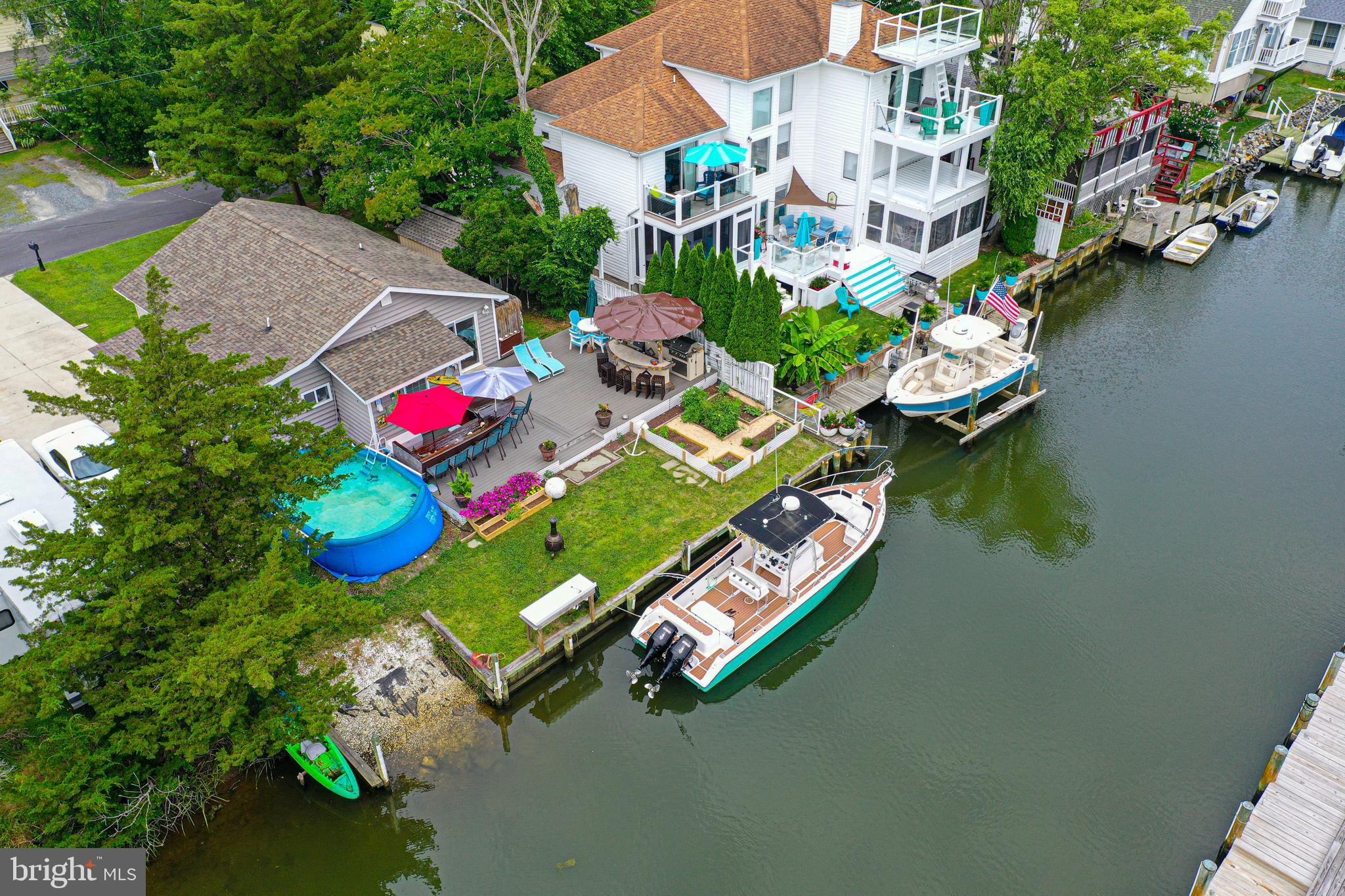 West Ocean City Waterfront Oasis with extensive outdoor living.  This amazing home offers beautiful Hardwood floors, ceramic tile, granite counters, Stainless steel appliances, custom cabinets, custom bathrooms with tile surrounds, granite tops and custom vanities.  The outside living space is awesome w/outdoor shower, large deck, built in grill, custom boat table and chairs, boat ramp, fish station and docking area.  Just a short distance to open bay!  The home is capable of future second floor expansion.  If you are looking for a home away from home on the water, then this one may be the one for you.