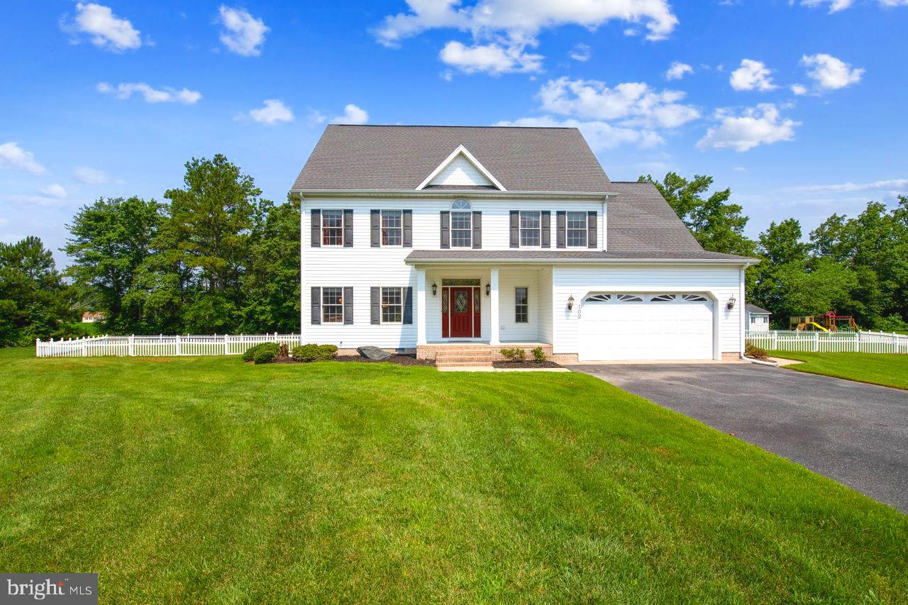 Immaculately maintained & comfortably-elegant 5-bedroom, 3.5-bath home on one of the largest lots in