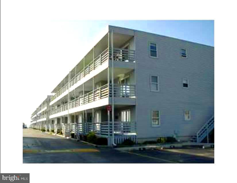 Price adjusted.....Mid-town location in Ocean City. This  2 Bedroom / 2 Bath spacious unit is just across the street from a low density beach. Enjoy lazy afternoons in the community Bay front pool. One block from the Convention Center. Walking distance to Amusements, Restaurants, Seacrets. Close to fun for everyone. Great rental potential. Bradley on the Bay offers  owner Two Parking spots, Boat Ramp Access, access to one boat slip with over 38 to choose from and access to one jet ski tie up and a storage area for your kayak or canoe. A full- time, year round property manager and night- time security is provided during the summer months. Bradley on the Bay also is Pet Friendly for owners and has a grass area to walk your dog! Rentals must be honored.