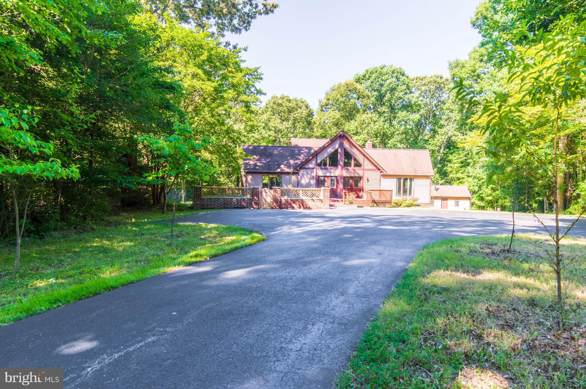 Contemporary & Serene. Privacy Abounds with this  4+BR  2500+sf home on 2.23 Acres w/ a detached 1 c