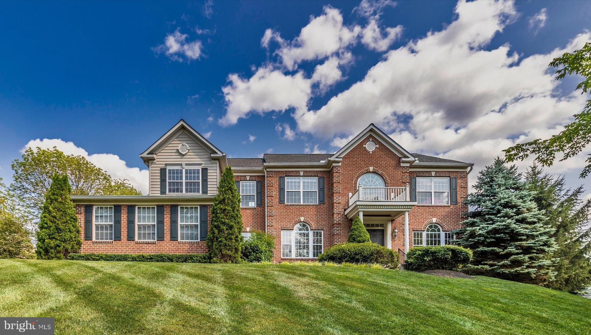 SIMPLY STUNNING...this designer inspired brick front colonial with over 6,000 sq. ft. of living spac