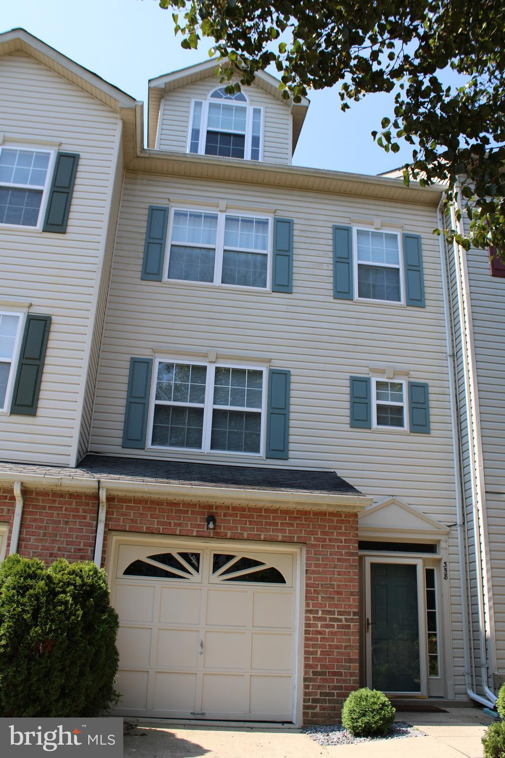 Well maintained 4 level town home in Chapline Village.  Tiled entry way leads to newly carpeted fami