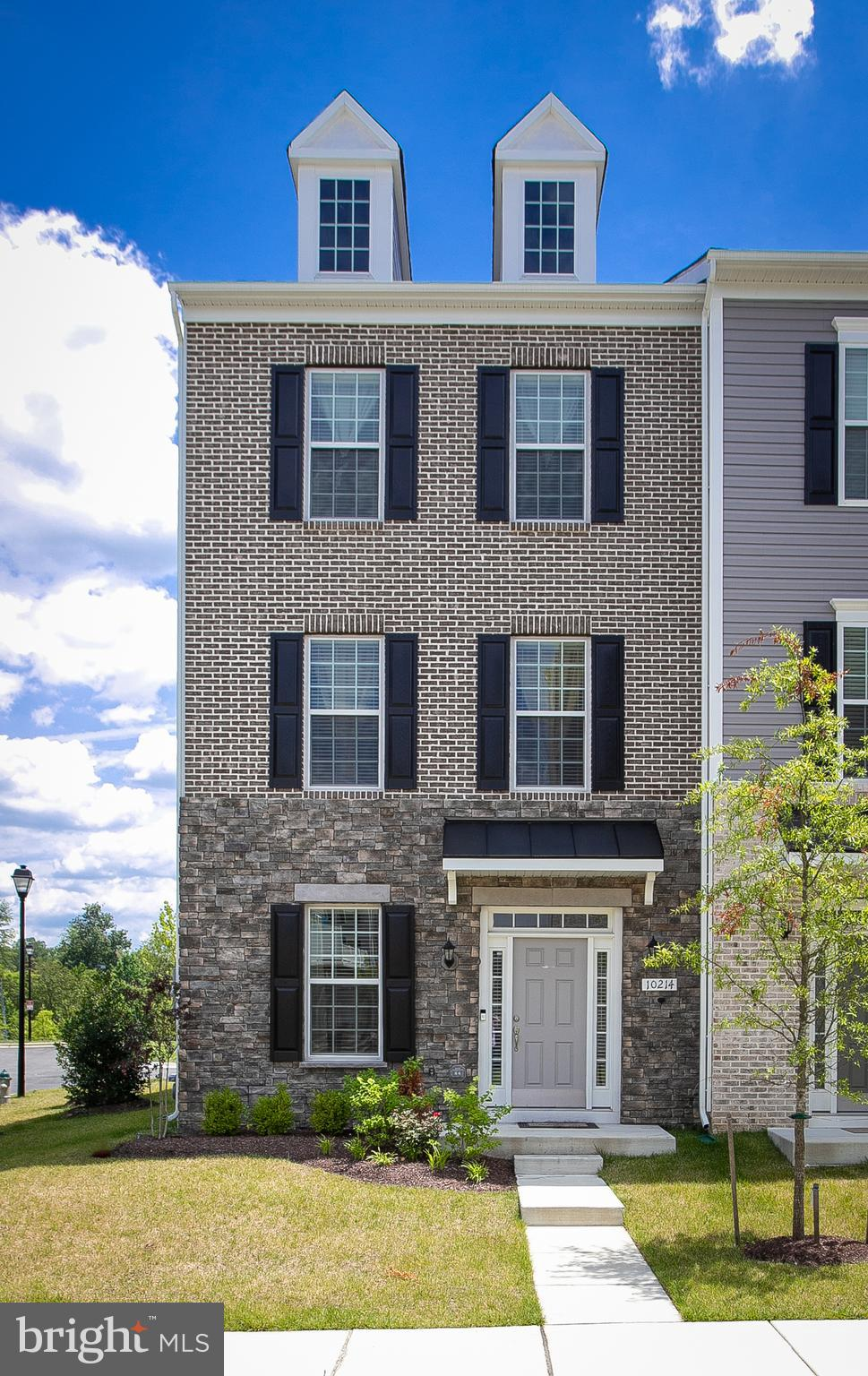 This stately end unit townhome features a stone and brick exterior, nicely landscaped and gently lived-in. The open floor plan extends from the living room to the kitchen, dining area, then the enclosed spacious deck.  There are beautiful hardwood floors throughout the main level, kitchen with tall cabinets, and loads of granite countertop space.  The center island is wide and has space for additional storage and seating. The upper level offers 3 generous bedrooms; the primary bedroom bath has soaking tub, separate shower, double sinks, and walk-in closet.  The laundry is on the upper level as well.  The lower level has a family room, full bath, and entry to the garage. The 2 car garage is completely finished, the concrete floor has an epoxy coating, and is painted for durability.  There is also space for two cars to park side by side outside of the garage.