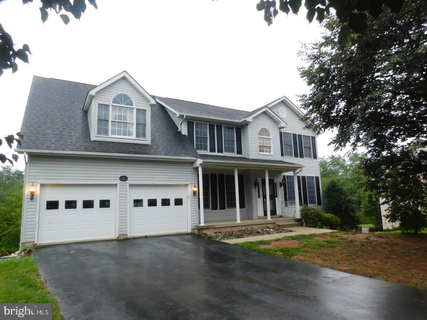 Price To Sell Fast! Desirable 3 Level Colonial In a Quiet Cul De Sac, 2 Car Garage, Walkout Basement