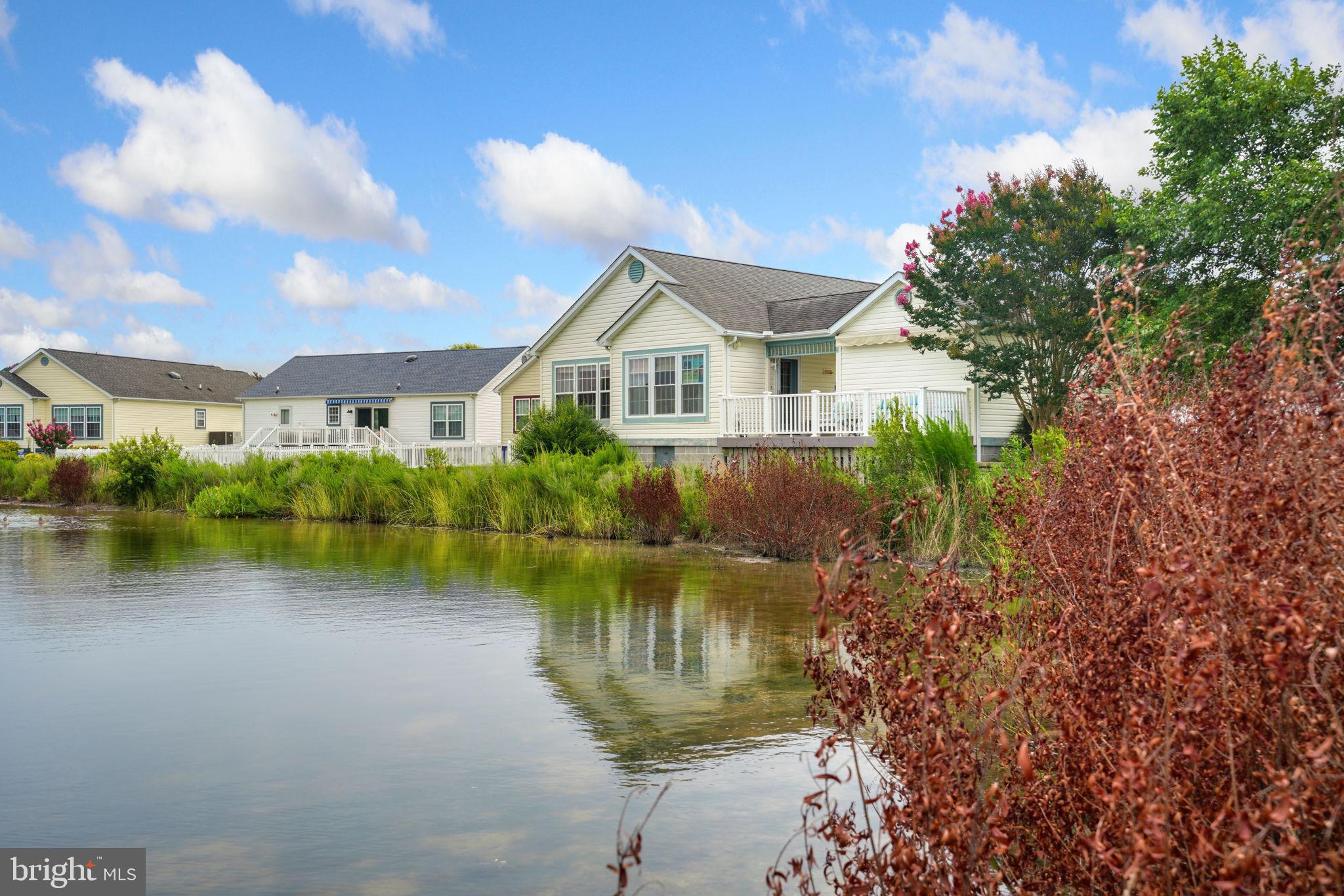 Welcome to this Fabulous Home is Bay Vista of Mystic Harbour. This Coastal Style home offers so much