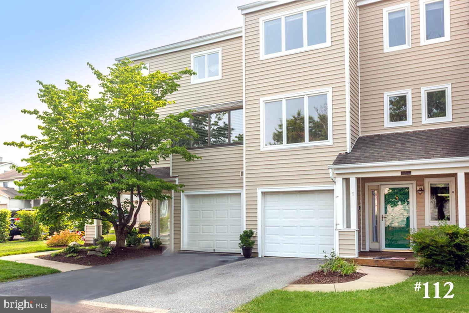 OPEN HOUSE Sunday  7/25/21 from 1-3 ! BRIGHT 'n'  BREEZY TOWNHOME with lots of windows framing WATER