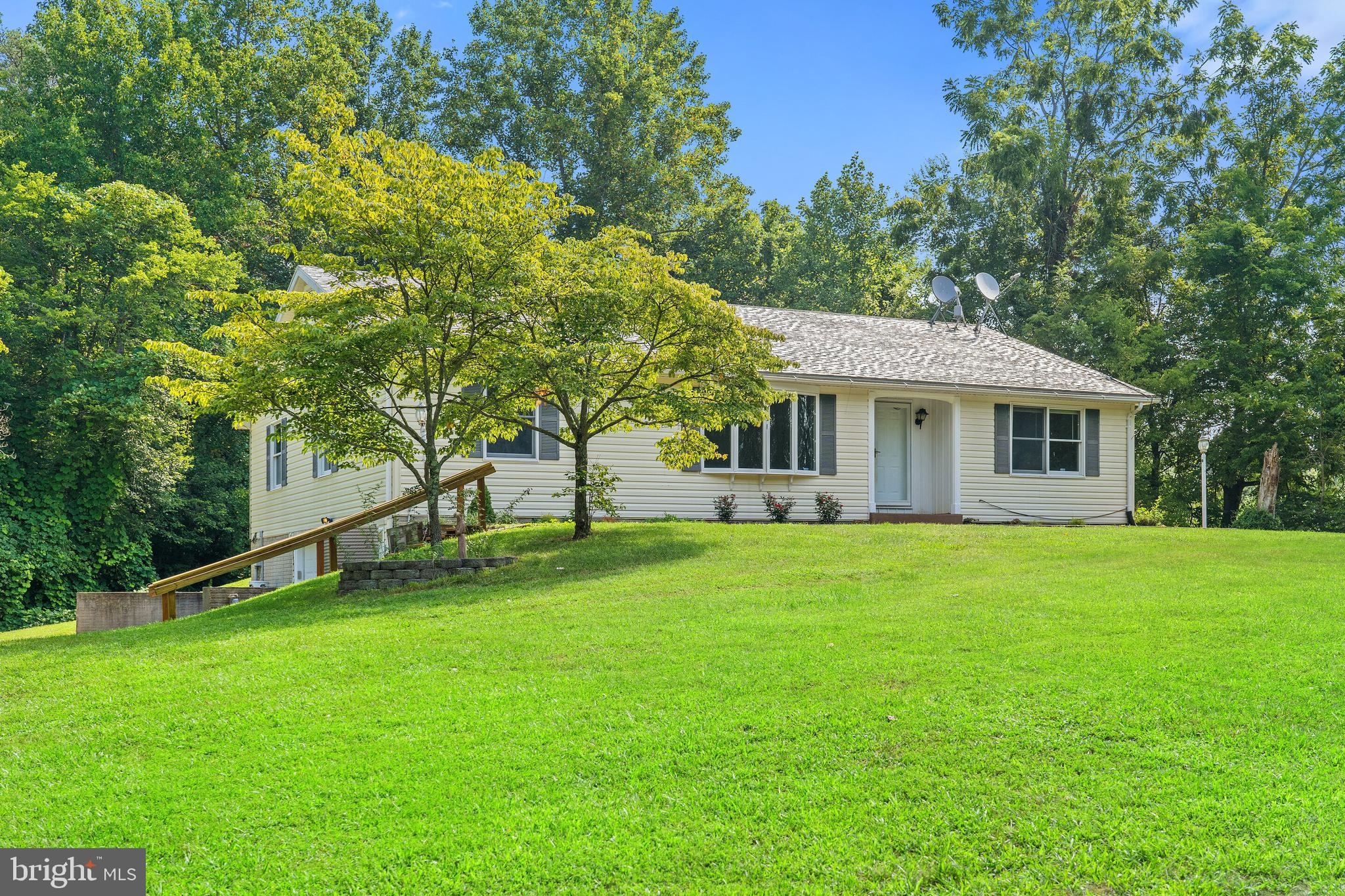 Tucked away on a secluded lot, this hidden gem is ready for its next owners!  Over 3200 finished sqf
