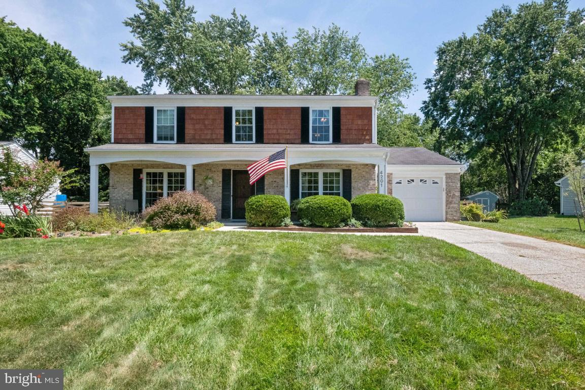 This lovely Bowie colonial is on a dead end street with a huge fenced lot. The front porch is so welcoming as you enter. The eat- in kitchen has loads of countertop space and leads you to a large patio area and nice backyard. The home has very large bedrooms (all with new ceiling fans) and a great family room with a fireplace. The HVAC was recently updated to a TRANE heat pump system and the home has updated kitchen & baths as well.  Some of the great extra's this home has are the large closets, laminate flooring in all the bedrooms and leaf guards on the gutters. The neighborhood is quiet, but still convenient.  This is a great location close to Rt. 50 and Bowie Town Center. Walking distance to shopping, restaurants, bike trails, and great parks and playgrounds.  Show and sell!