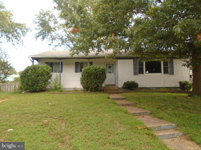 This Rancher is situated on a corner lot.  Enclosed sun room off dining room in rear.  Back yard has