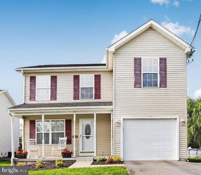 Clean, spacious and adorable. This well maintained Colonial boasts 3 large bedrooms, 2.5 baths and a
