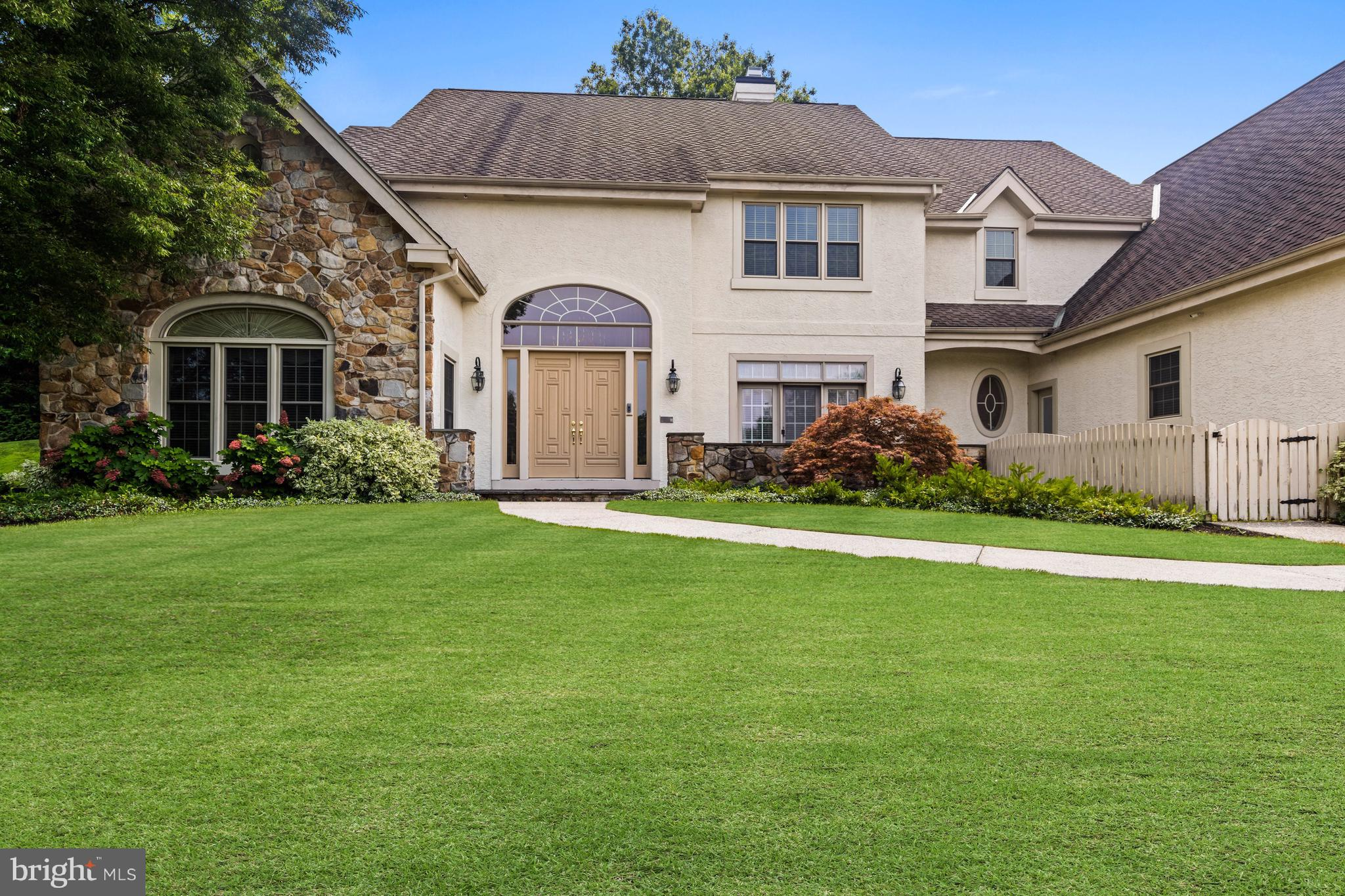 Set on a generously sized lot in the desirable neighborhood of Merestone sits this custom designed a