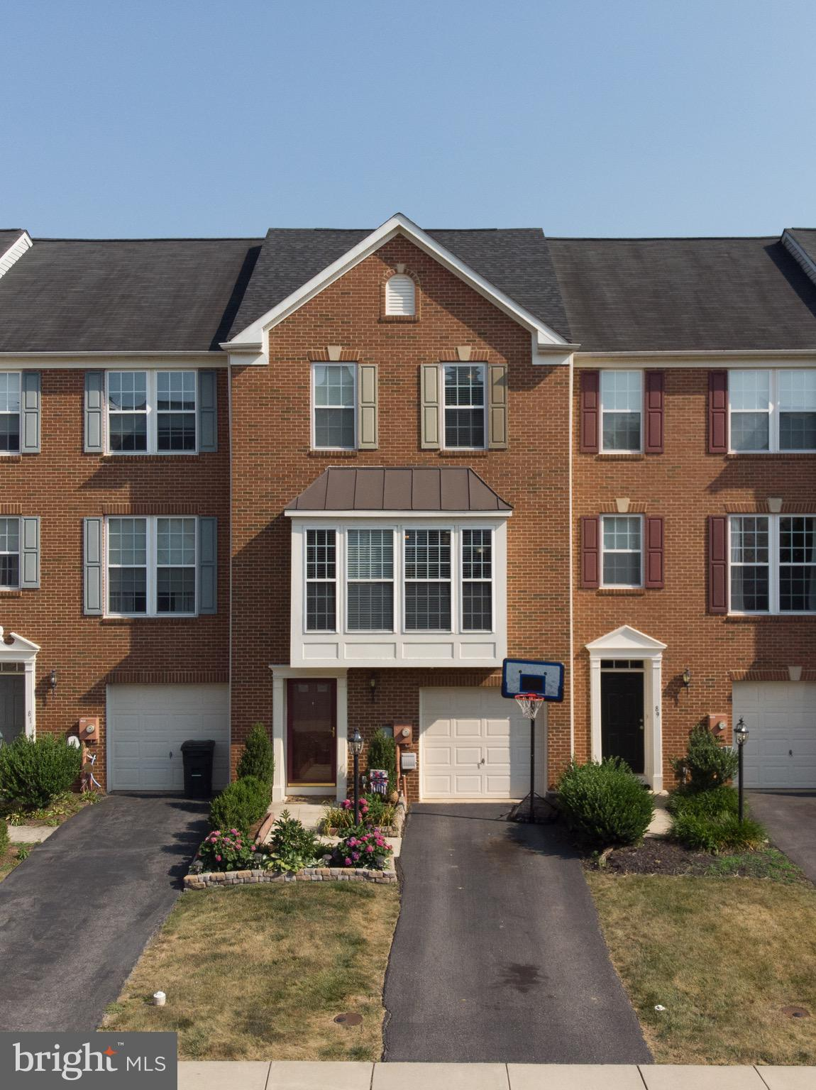 Beautiful luxury townhome in sought after Windmill Crossing.  Brand new patio that provides shade an