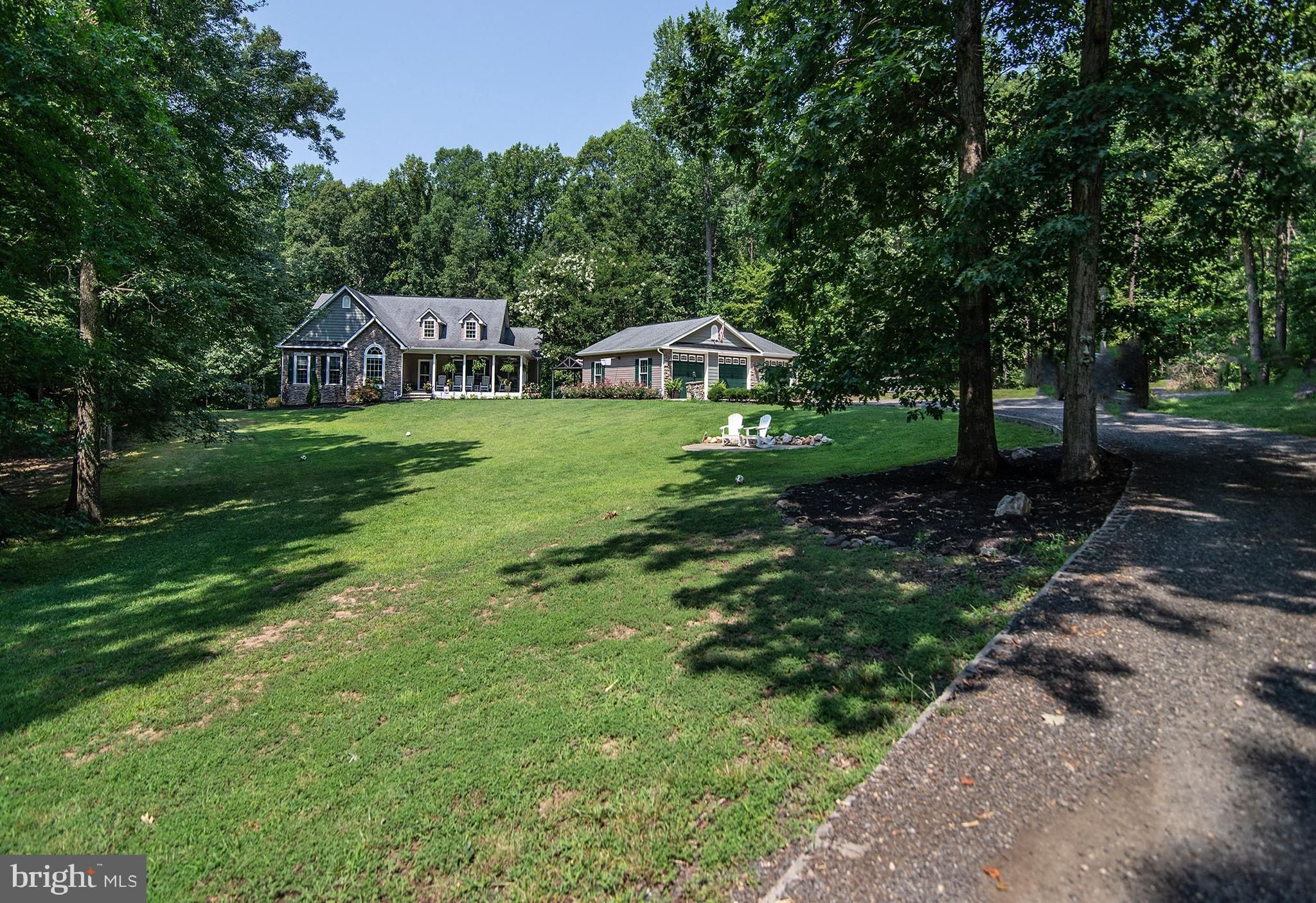 A must to see!   This charming and cozy custom built home has all bells & whistles!  Master Bedroom