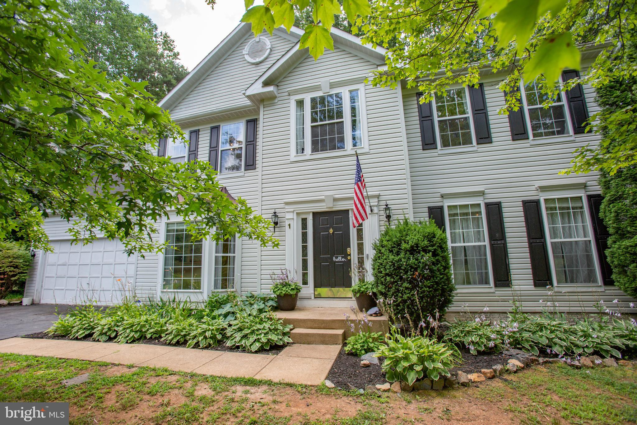 Welcome to 1 Longfellow Court in the Shelton's Run neighborhood of Stafford.  This truly gracious home is the one you have been waiting for.  With a hard-to-find 5 bedroom/ 3.5 bath open concept layout, updated kitchen, and a great outdoor area,  this house has something for everyone.  It's a perfect blend of a traditional center hall Colonial and more modern open- concept living.  Step into the large entry foyer with neutral paint and beautiful wainscoting details.  The formal living room/flex space is to the right of the entry and features crown molding.   Across the foyer you will find the formal dining room with custom built ins and doorway to the updated kitchen.  If  you enjoy entertaining,  you will love the flow of this space.  Whip up a meal for friends while still being a part of the conversation.  An oversized  granite island offers seating for 4, and the bump out sunroom area easily accommodates a table for 8.  The family room  has a cozy gas fireplace and plenty of space for your furniture.  Your entertaining won't be limited to indoors,  with a screened porch area that provides access to your  fenced backyard.  The mature trees offer welcomed shade for the sunny Virginia summers while also offering privacy from your neighbors.  Imagine evenings catching up with friends around your fire pit, roasting marshmallows, sharing stories,  or simply enjoying the quiet of your 1.3 acres.  Head back inside and  up to the bedroom level to find four generously-sized secondary bedrooms that share a spacious hall bath with dual sinks.    The Owners' Suite is over 300 (18.6x17) square feet in size and has a walk-in closet and en suite with dual sinks.   The fourth bedroom has been updated to make a  suite with bedroom and  separate sitting area/ office behind chic barn doors.   If the past year has forced you to integrate work or school into your home life, this room would allow for work/school space that can be closed off when the work day is done.   If you need even