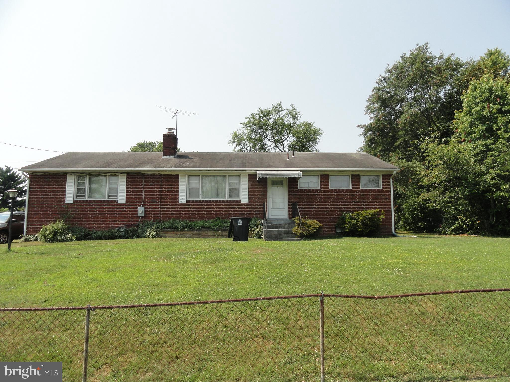 Brick Rambler in Clinton comfortably containing 3 bedrooms and 3 full baths  with beautiful hardwood