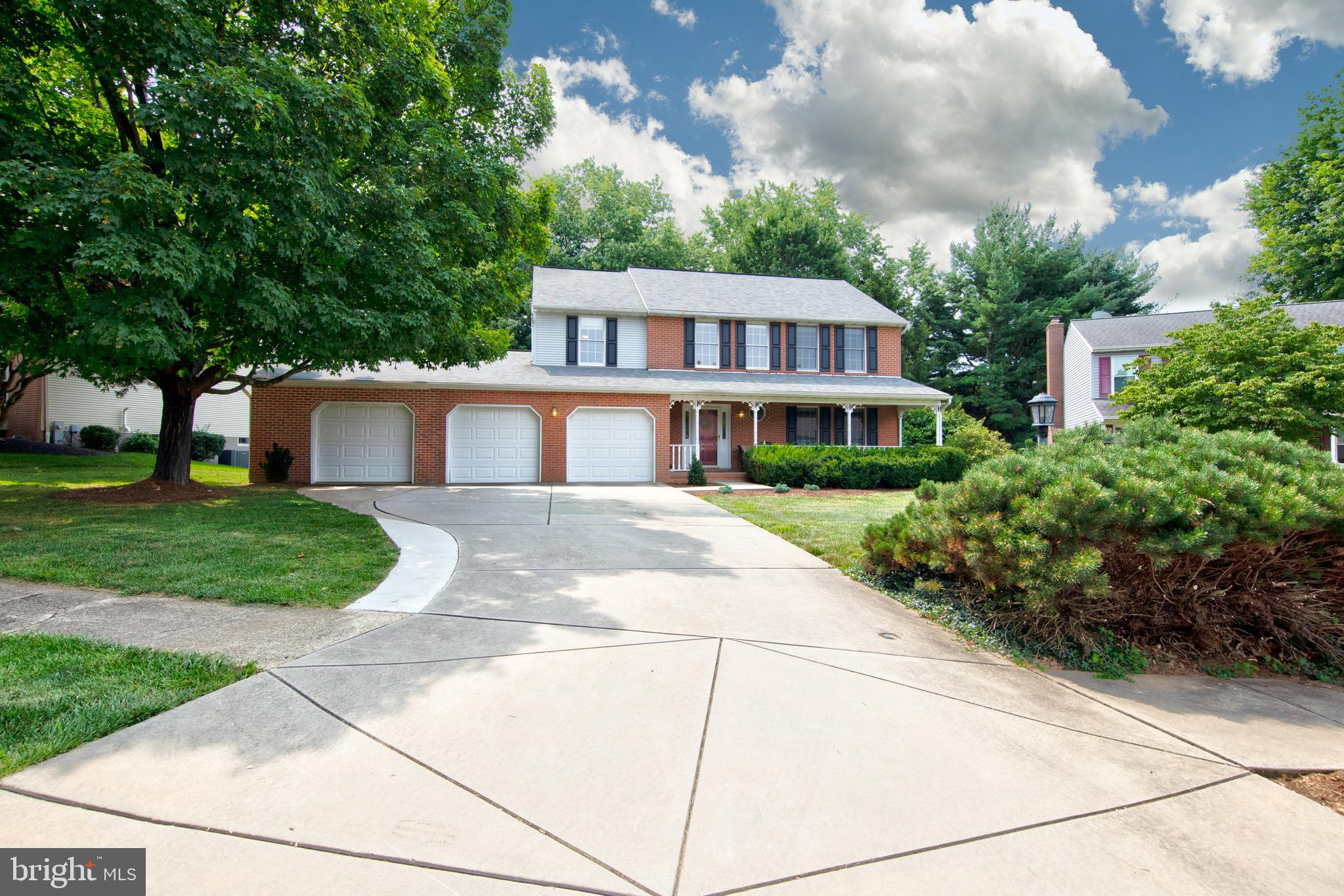 What a great deal!  Nicely updated brick front colonial with rarely available 3 car garage in sought