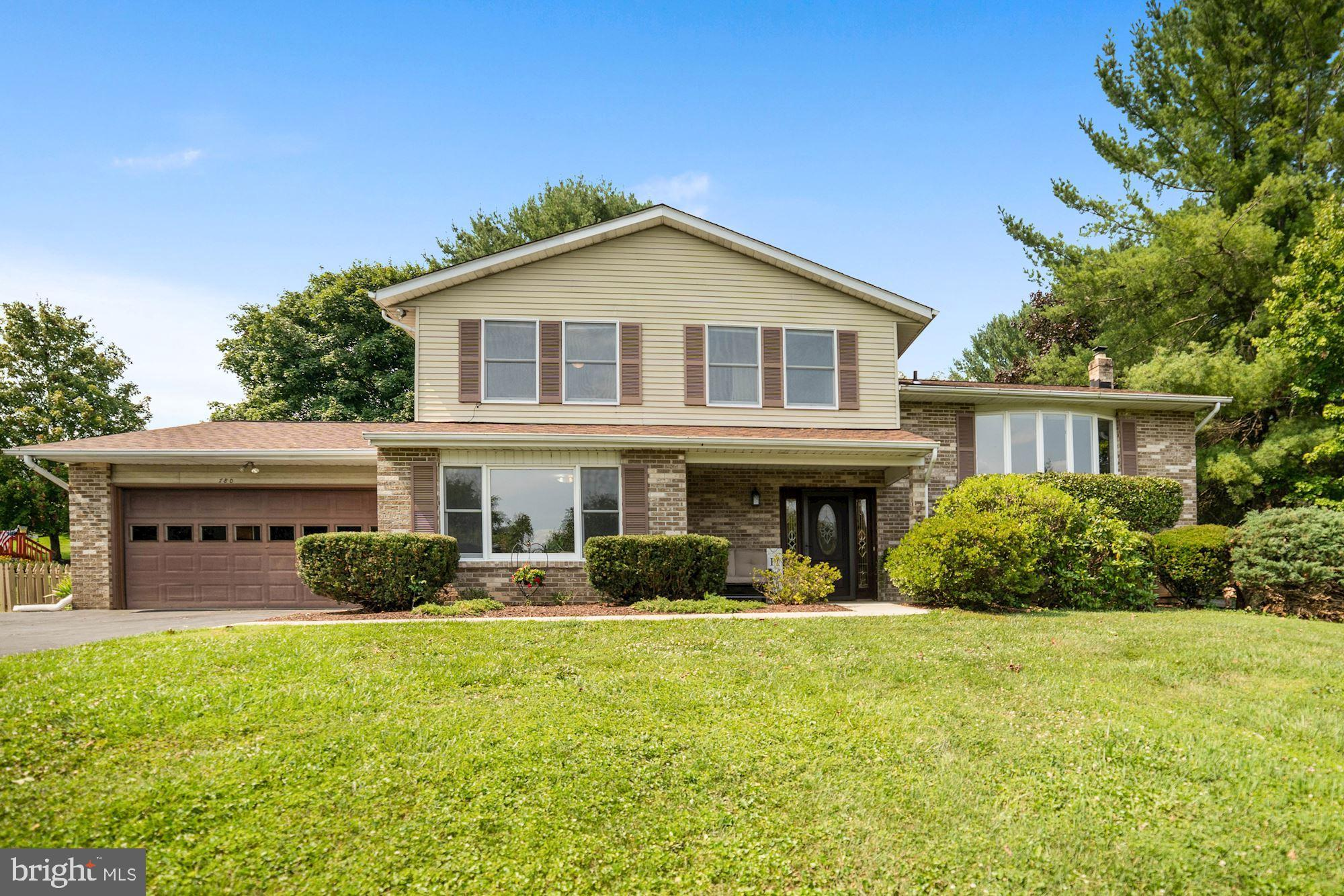 Welcome Home to this Spacious 3-4 Bedroom , 2.5 bath, split level home in a sought after neighborhoo