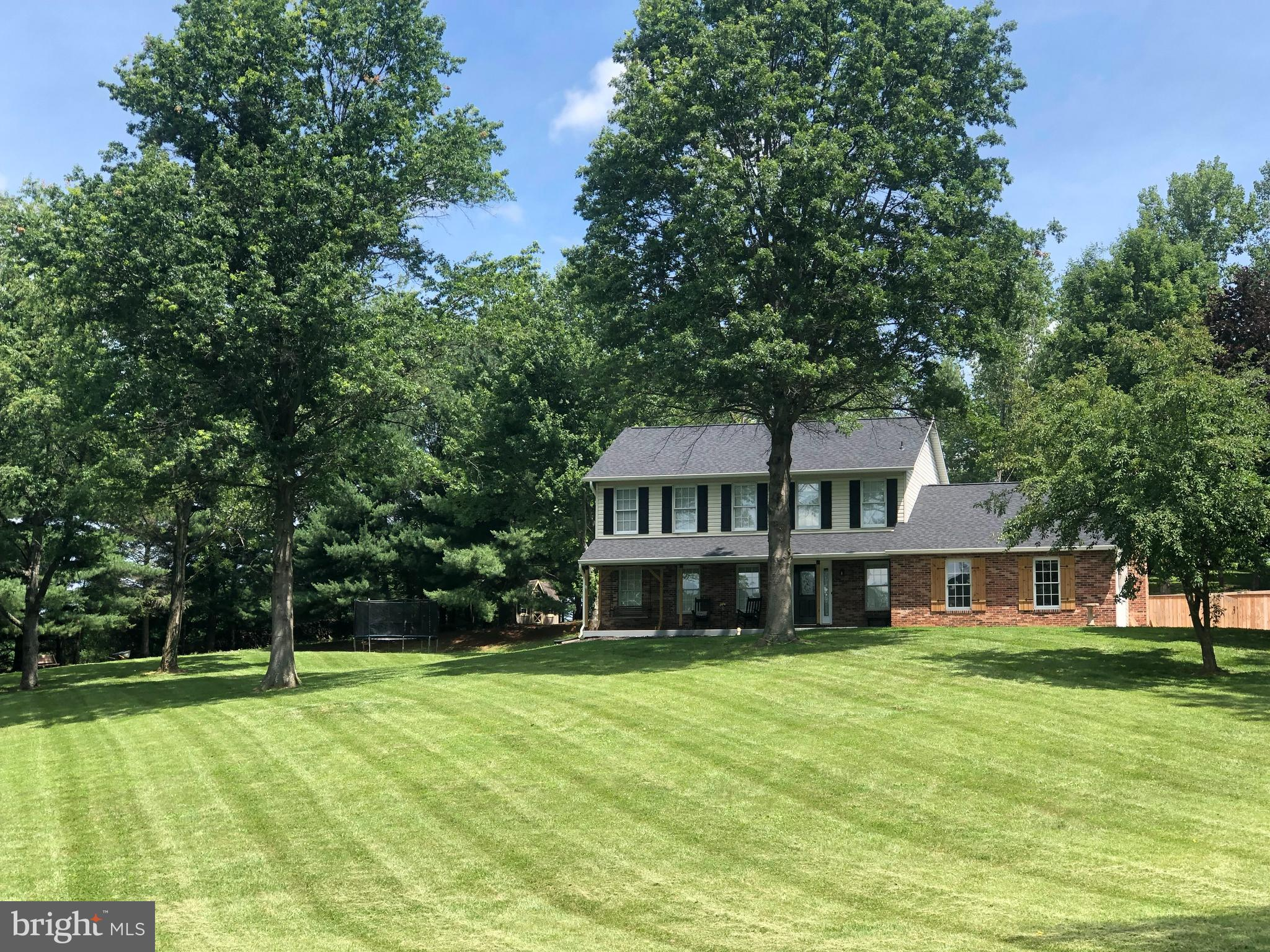 COME TO THE OPEN HOUSE for this beautiful home in Carroll County on July 17, 2021 from 11-1.  This gorgeous completely updated colonial style home is nestled up on a hill overlooking 3 acres of land.  With a remodel in excess of 150K to include brand new kitchen and appliances, new roof, A/C units (upstairs and downstairs), hardwood floor, this home is move- in ready!  On the first floor, you will enjoy nice family meals in the brand new eat-in kitchen with a custom-built bench that includes extra storage space or at the granite counter bar.  Relax and keep warm on those cold nights by the recently renovated masonry fireplace.  Upstairs you will find 4 bedrooms including a master bedroom with a newly renovated stunning master bathroom.  In the basement, there is plenty of space for family movie night or an exercise area with an updated half bath, utility room, storage space, and basement walkout for easy access to the backyard and pool.  You will have plenty of space for your vehicles in the 2-car garage and extra driveway pad for parking.  Walk through the new fence and you will feel like you have entered paradise, when you see the newly renovated HEATED pool.  Soak up the sun on the newly built wood deck and enjoy the privacy and peacefulness of your own sanctuary.  After a full day of swimming, walk over to the firepit, where you can enjoy the tranquility of the evening sunset.  This home is near top rated schools with close access to interstates 70 & 270. Don't miss the opportunity to make this beautiful home your own!
