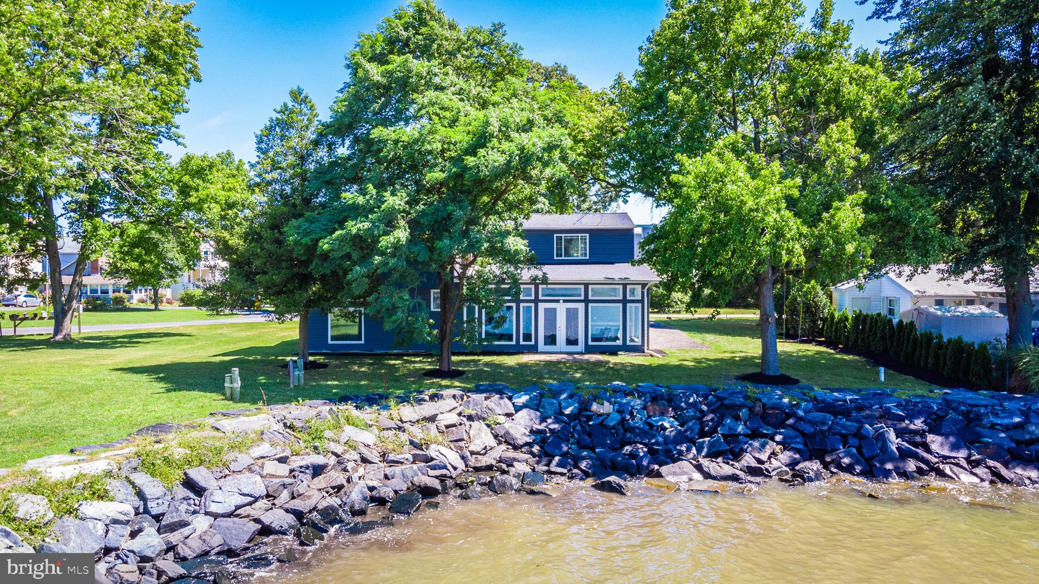 Watch the sunrise in a beautiful waterfront retreat less than an hour from the district. This house