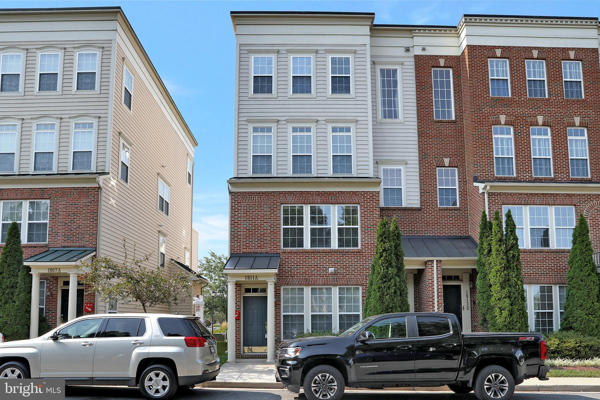 This inviting two story end unit condo offers a great open floor plan in a fantastic and convenient