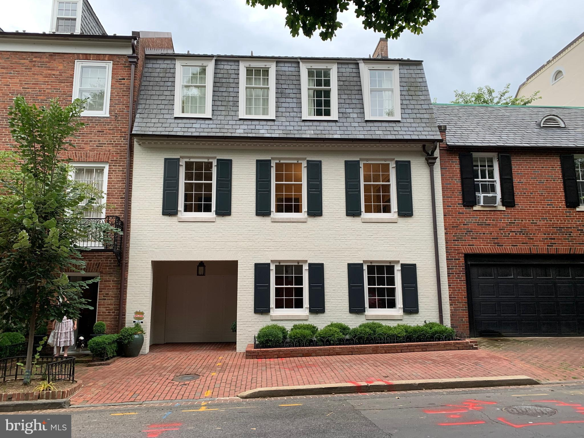 Beautiful interior row house designed by renowned DC architect Walter G. Peter Jr. Nearly 5,000sq/ft