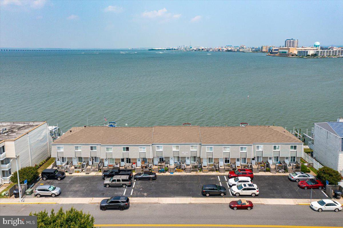 Perfect location, boat slip, pool & incredible views all available here at Bay Cove on 32nd St! This townhome comes furnished & ready to enjoy for the (locals favorite) fall season. Close to the boardwalk w/o being right on it & near a ton of incredible midtown eateries. Beach, pool or bay day, choice is yours with a great community pool for only Bay Cove owners. Hit the bay with your boat, kayak or paddleboard right off of your back dock. Catch your dinner & enjoy dining on your deck with those beautiful sunset skies the bay side offers. Low condo fees at $258 monthly which includes master & flood insurance, pool & exterior maintenance of building..  Seller providing a 1 year AHS home warranty! Saturday showings 10-2:00.