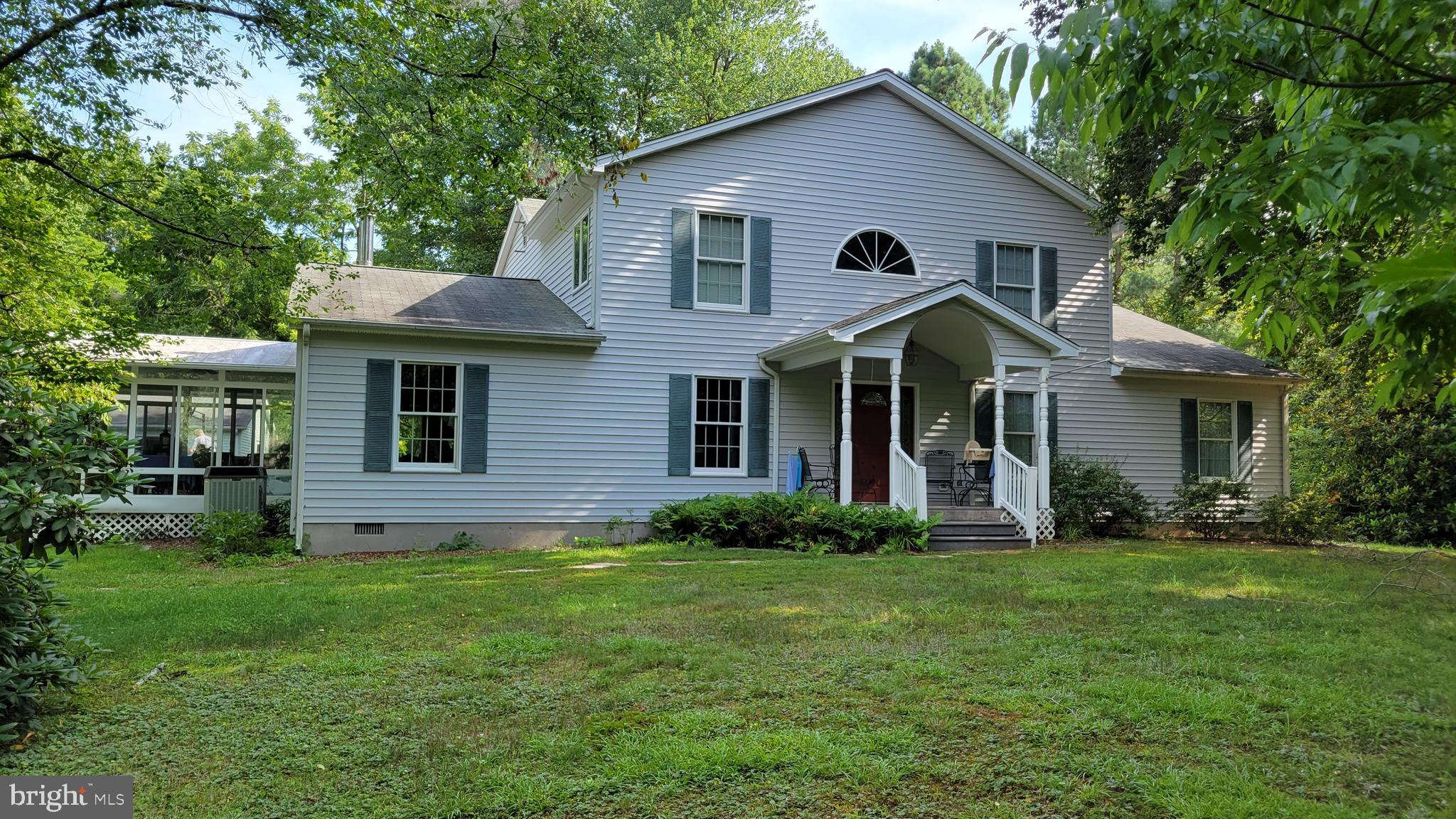 The tax record may say this home was Built-in 1876 But that is only the original 4 rooms! There were additions/renovations performed in 1937,  1957, 1987, 2000, and the most recently in 2012! So much so that the original four room house is now over 3,600 square feet! Included in this spacious home is an enormous Main bedroom suite consisting of an approximately 15x28 bedroom with its own gas fireplace, and his/her walk-in closets  leading to a spacious private bath with large walk-in shower and double vanity.  Also downstairs, there is a HUGE family room adjacent to the modernized kitcgen, a separate living room, a library/office,  a sitting room off the kitcben, a beautiful, large sunroom, and one more full bath as well as a powder room. Upstairs you will find three more bedrooms, a full bath, and another room that could be a bedroom NTC. All this on 1.23 acres in a private, quiet neighborhood. And did i mention the HUGE approximately 48x28 detached garage with 3 bays and a work area on a paved driveway?? The large separate carport also??? What are you waiting for??