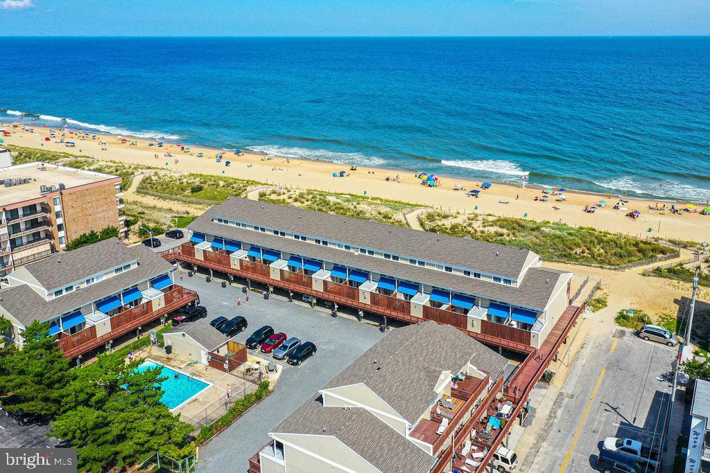 DO YOU WANT THAT  SPECTACULAR DIRECT OCEANFRONT BEACH RETREAT OR AN INCREDIBLE INVESTMENT PROPERTY??!! This is absolutely it!!  Enjoy stunning ocean views each day from sunrise to sunset on any one of the 3 balconies. You must view this  very desirable Oceanfront unit in Beach Place North, because it won't be here tomorrow!   Your entire family will love the  memories that will be made here on 71st street with lots of space & fun for all!  Completely furnished & waiting for you... 4 BR/2.5 Baths plus an outside shower & your own private fenced beach area! Updated with central AC-new in 2019, building has New roof w/CAT 3 Hurricane compliance-2019.  Plenty of storage, Laundry in unit on ground level, 2 Car covered parking, Awnings on back porch & extra storage too!  Beautiful shiplap on walls, wood flooring and some carpeting throughout. New carpeting on staircases-2019, updated baths. Newly stained decks and some new outdoor furnishings too.   The complex  has convenient pool and plenty of overflow parking right on the premises.  Use this for your family and friends or use it as a great rental investment with over $50k in rental income consistent for last few seasons!  Building has 'walls in' Insurance  so all you cover is your contents!!  Make your beach dreams come true here at Beach Place North!!  Super location close to shopping and lots of restaurants!  Serious buyers only, Saturday showings only/no exceptions 1130-230 pm.
