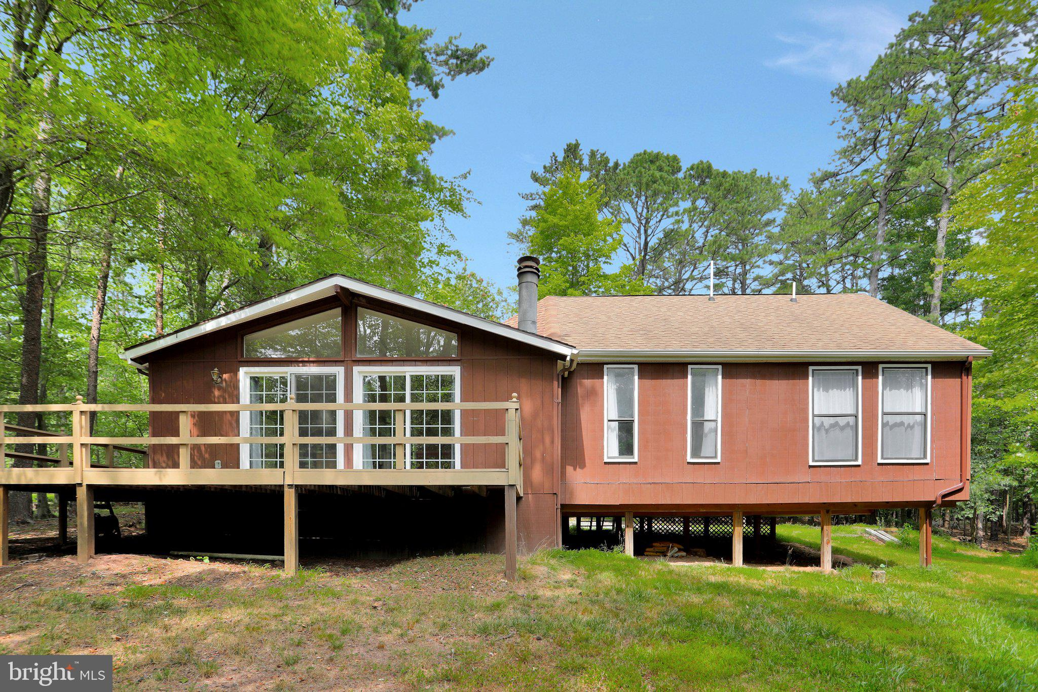 3 bed, 2 bath log home is situated on .81 acres. Large master suite with a huge walk-in closet and f