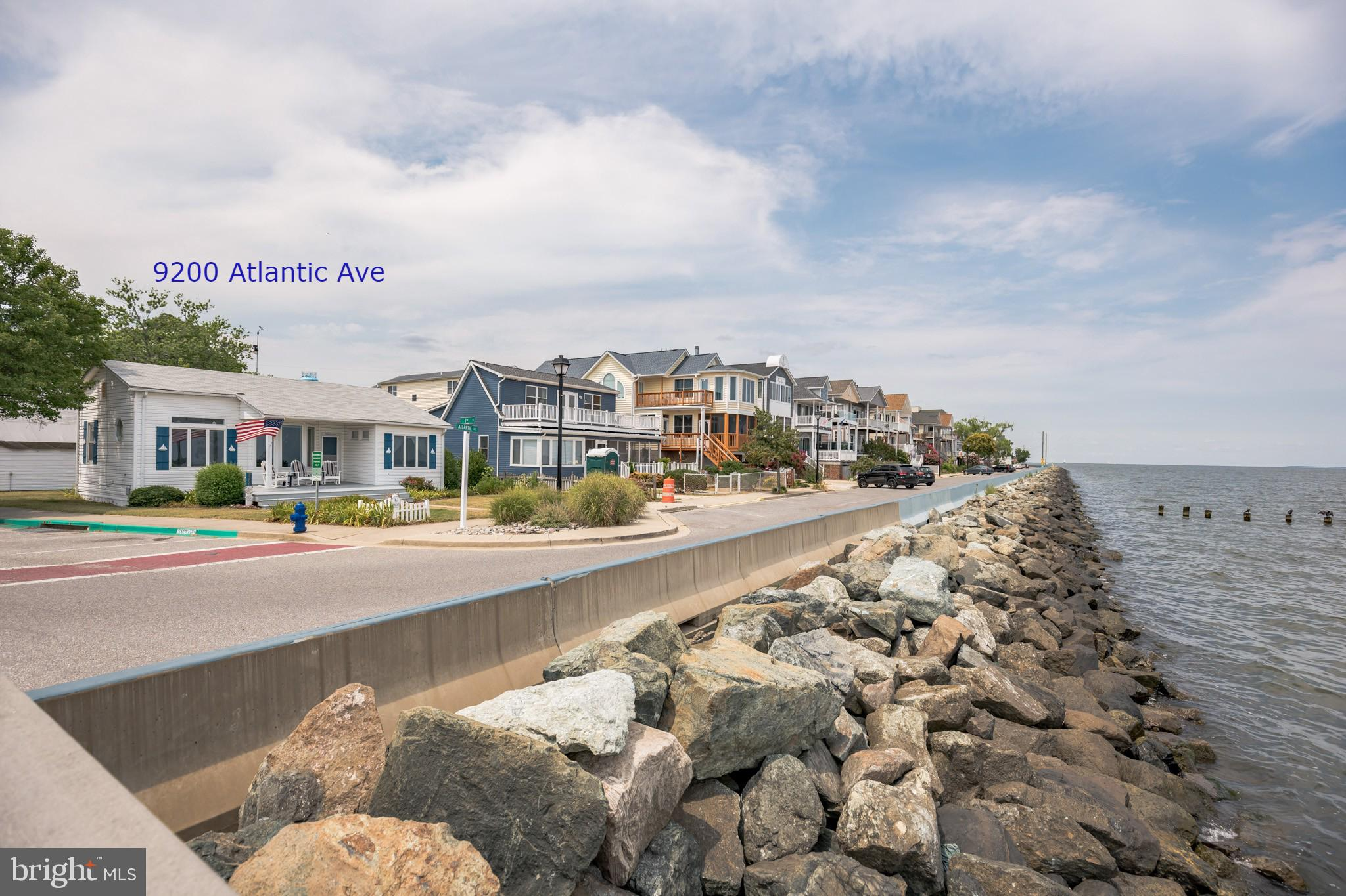"""Location! Location! This charming updated BAYFRONT cottage """"Skipjack"""" is on a double corner lot and"""