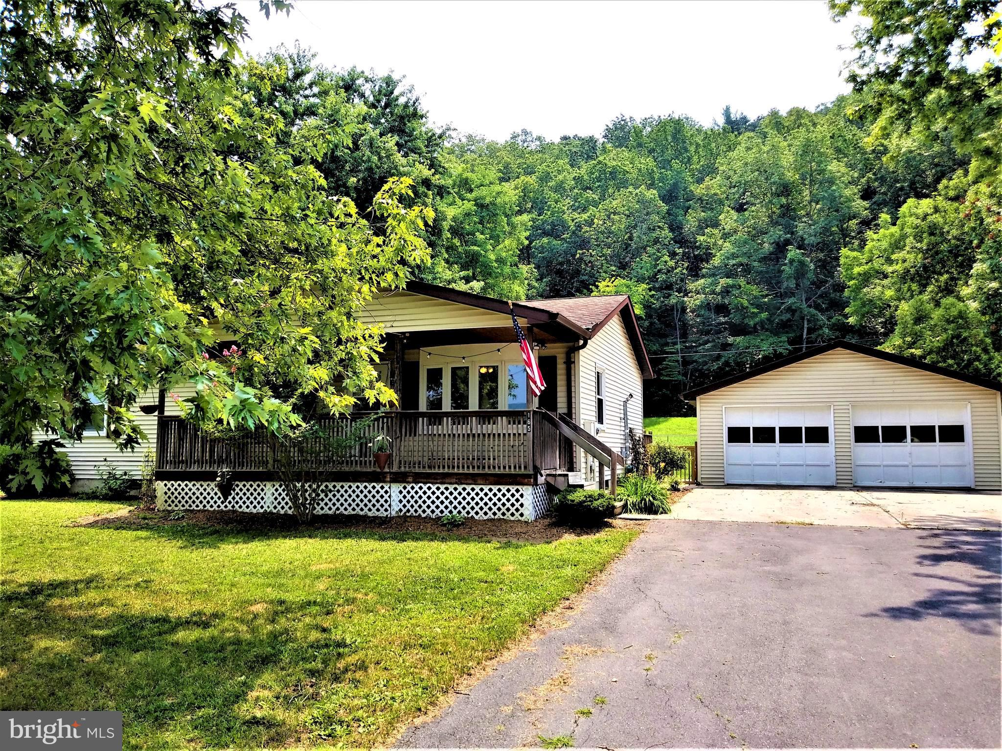 Well cared for home in quiet Wardensville with mountain views. Special features include: front and back porches, 2-car garage, newer wood floors, modern stainless appliances, pantry, large fenced back yard, public water and sewer, multiple heat sources, and paved driveway. Only 35 minutes from Winchester.  Short distance to town to the farmer's market, restaurants, shopping, bakery, library, fitness center, town hall, and shops located throughout the town. Near George Washington National Forest, Trout Pond, Warden Lake, and more.