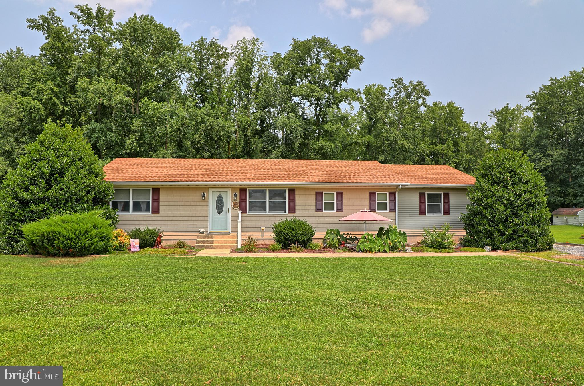 Nestled on over 2.5 acres in the quiet countryside of Georgetown, this 4 bedroom 2 bathroom rancher