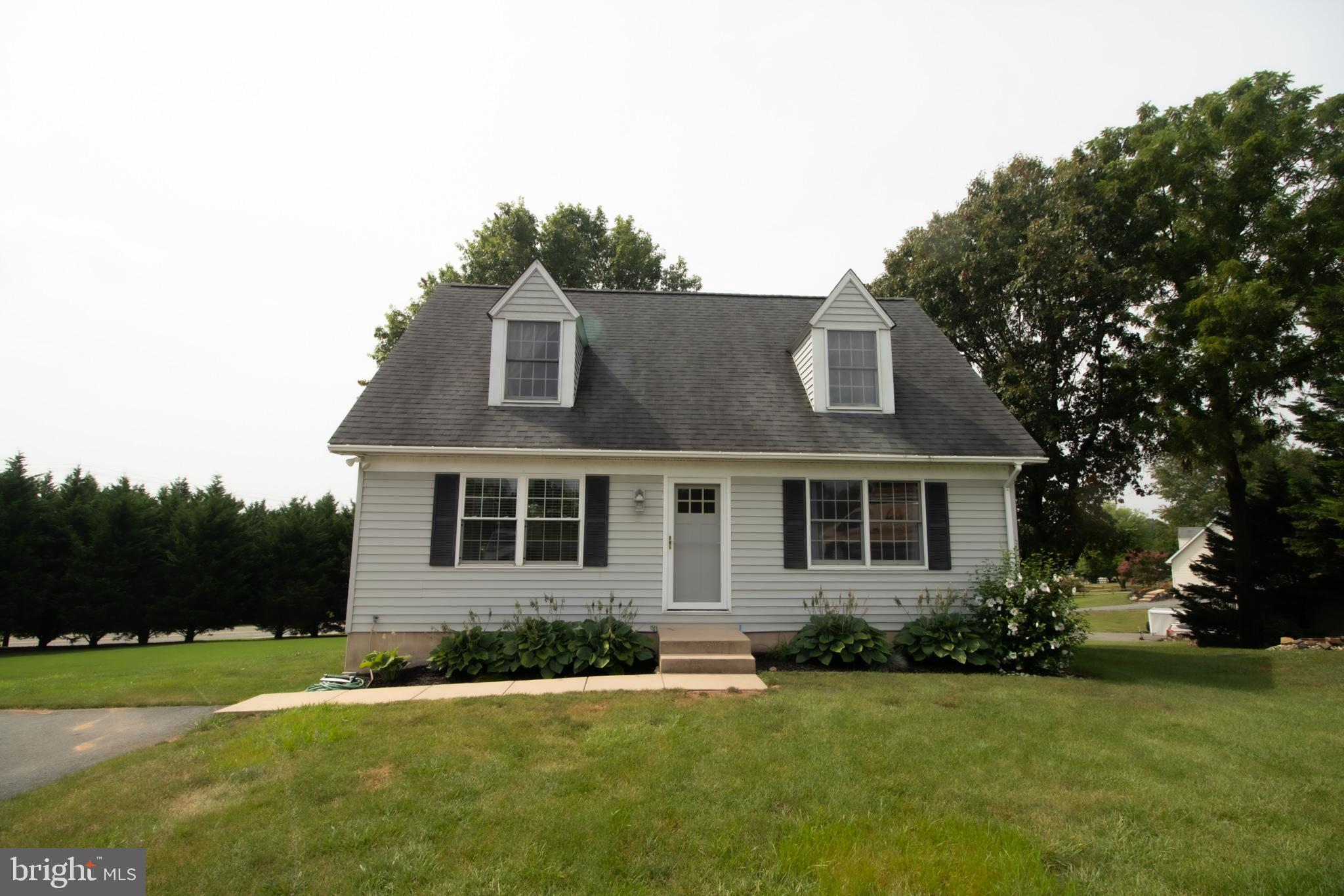 This Cozy cape cod features 3 bedrooms, 2 full bath with a full basement on almost 3/4's of an acre.
